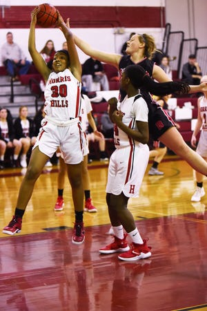 Boonton Vs. Morris Hills girls basketball game at the Morris Hills Holiday Tournament in Rockaway on Friday December 28, 2018. MH#30 Tamiya Turner has the ball.