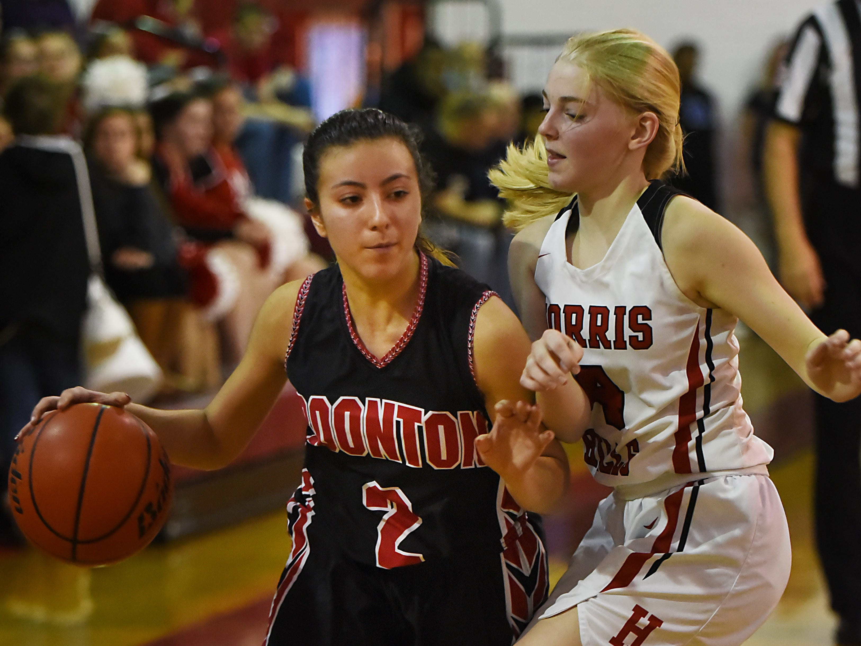 Boonton Vs. Morris Hills girls basketball game at the Morris Hills Holiday Tournament in Rockaway on Friday December 28, 2018. B#2 Sara Rios and MH#4 Maggie Lenahan.