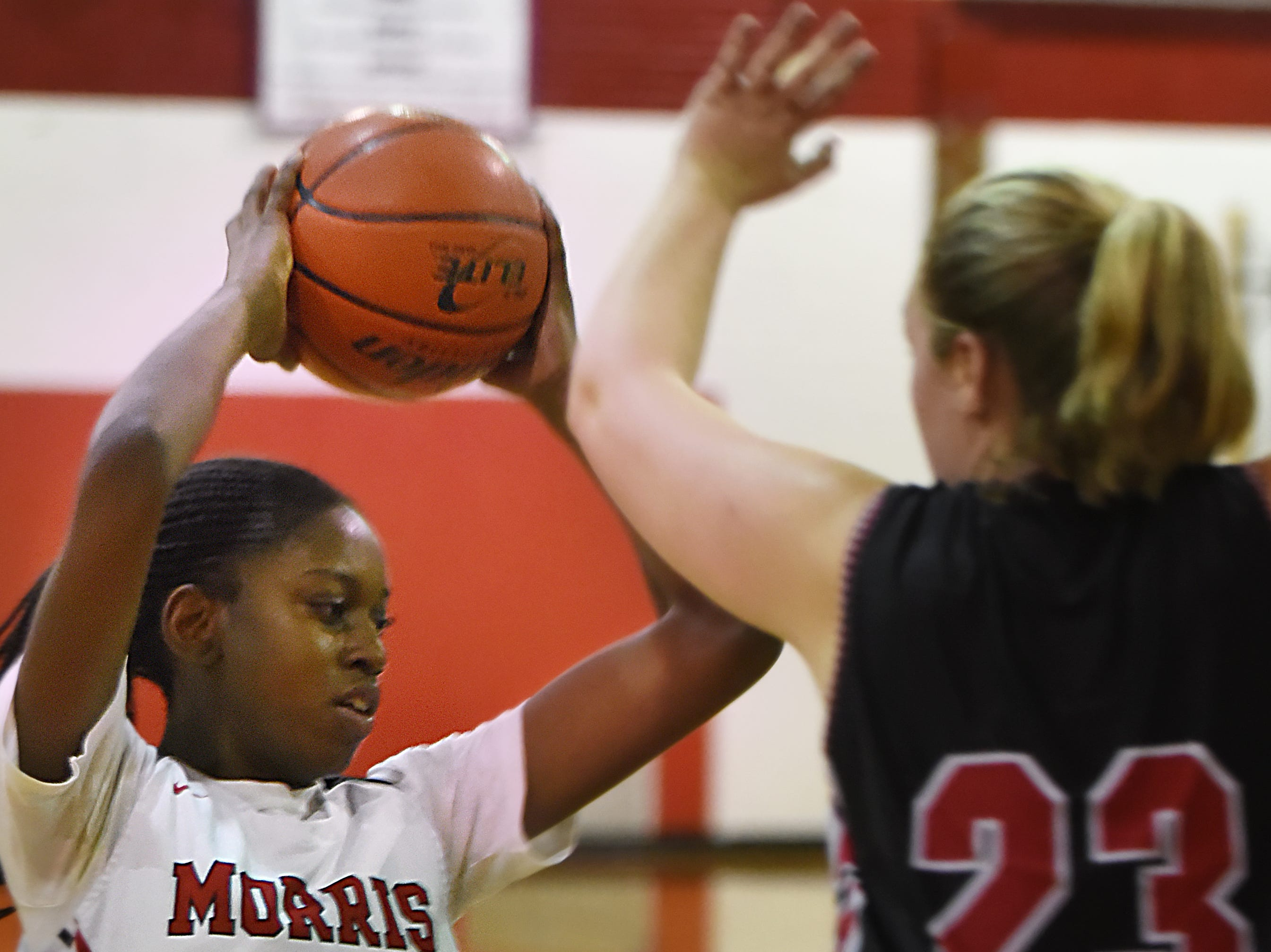 Boonton Vs. Morris Hills girls basketball game at the Morris Hills Holiday Tournament in Rockaway on Friday December 28, 2018. MH#24 Semaya Turner and B#23 Devin Gibbs.
