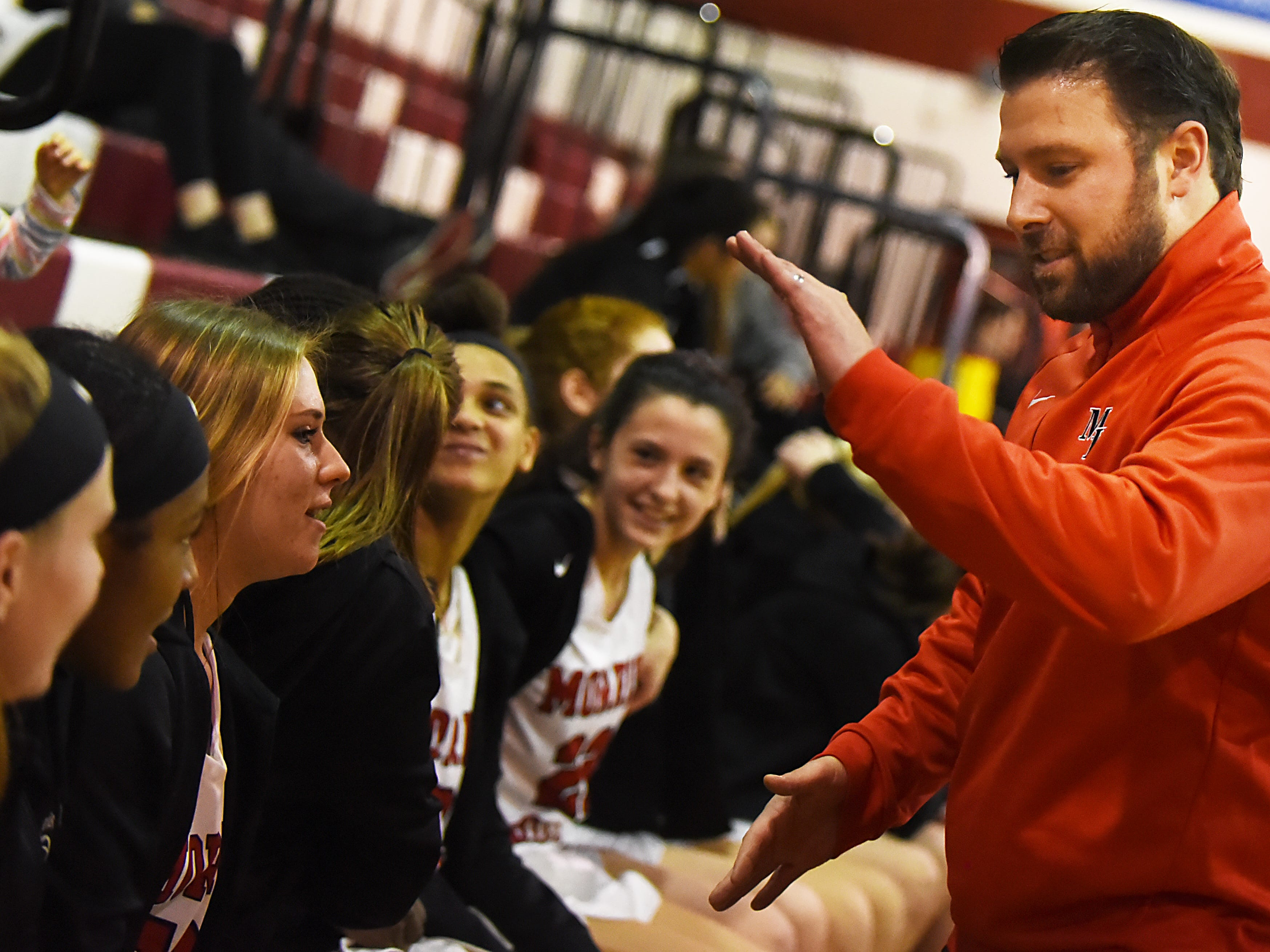 Boonton Vs. Morris Hills girls basketball game at the Morris Hills Holiday Tournament in Rockaway on Friday December 28, 2018. Morris Hills coach Brian Dillon congratulates the team on their 53 to 27 win.