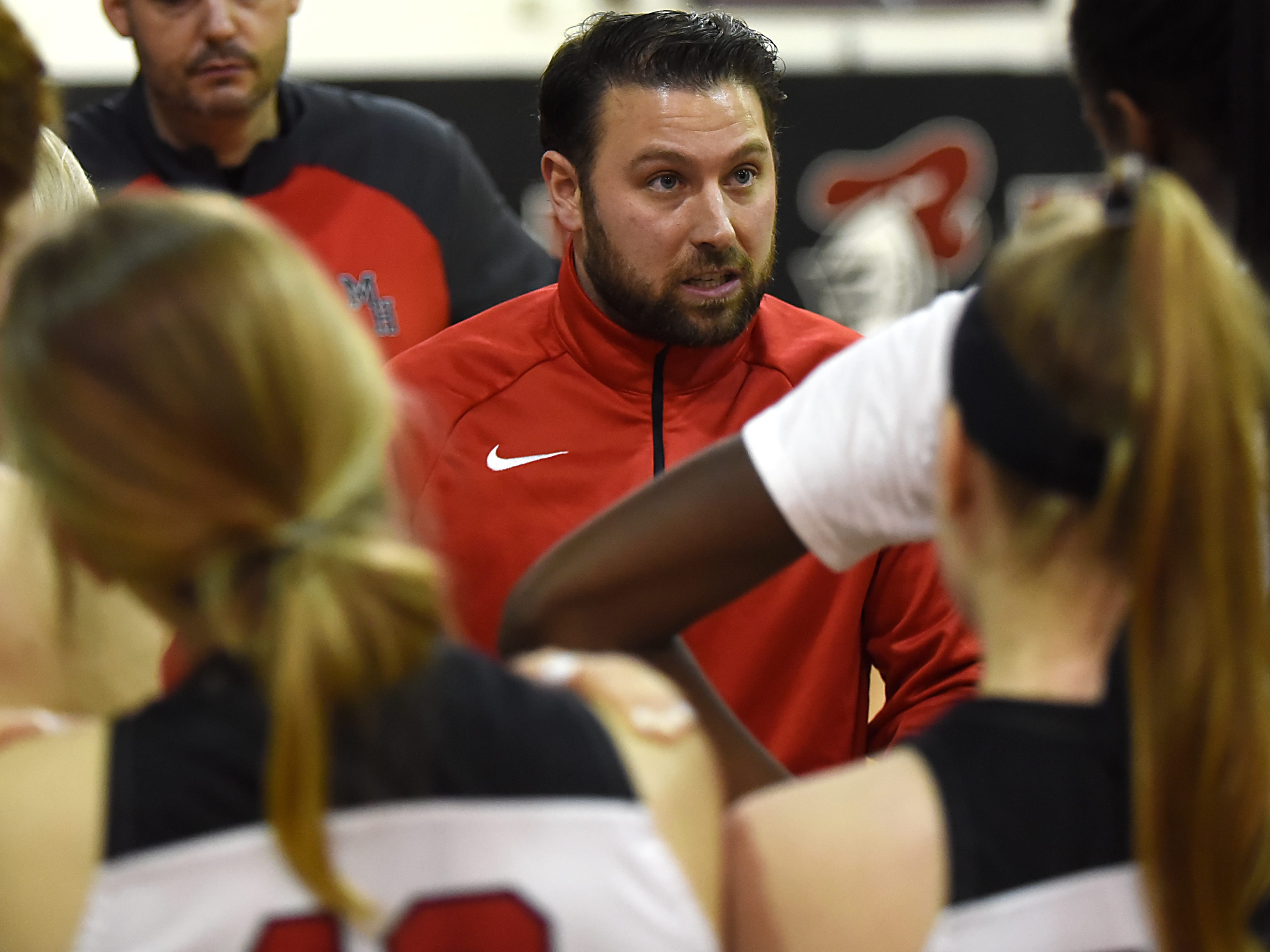 Boonton Vs. Morris Hills girls basketball game at the Morris Hills Holiday Tournament in Rockaway on Friday December 28, 2018. Morris Hills coach Brian Dillon talks to the team.