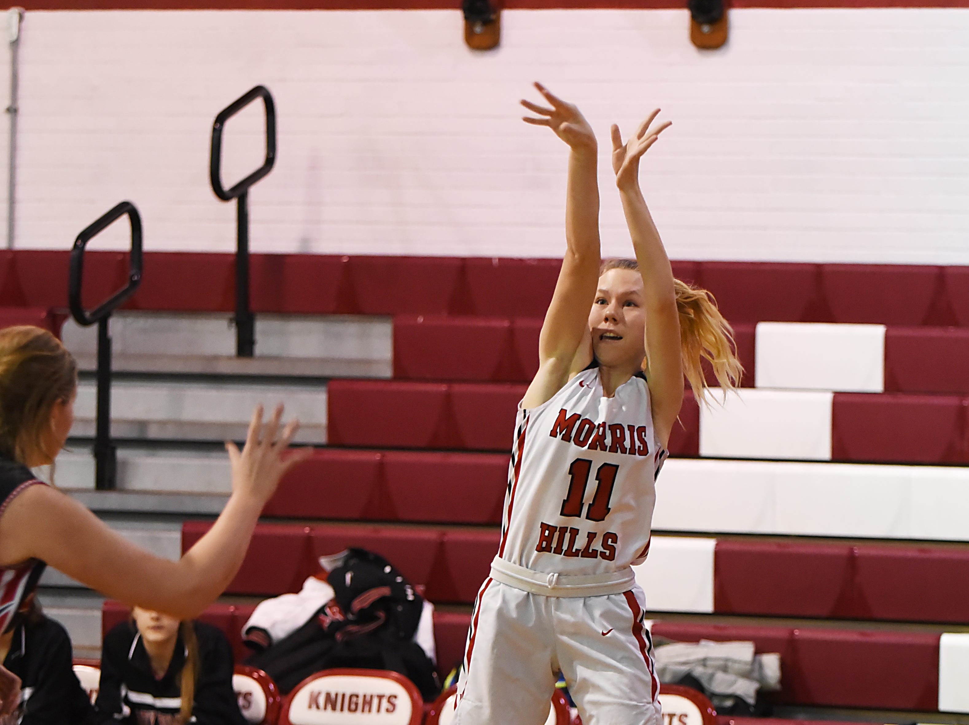 Boonton Vs. Morris Hills girls basketball game at the Morris Hills Holiday Tournament in Rockaway on Friday December 28, 2018. MH#11 Lauren Monarque throws the ball.
