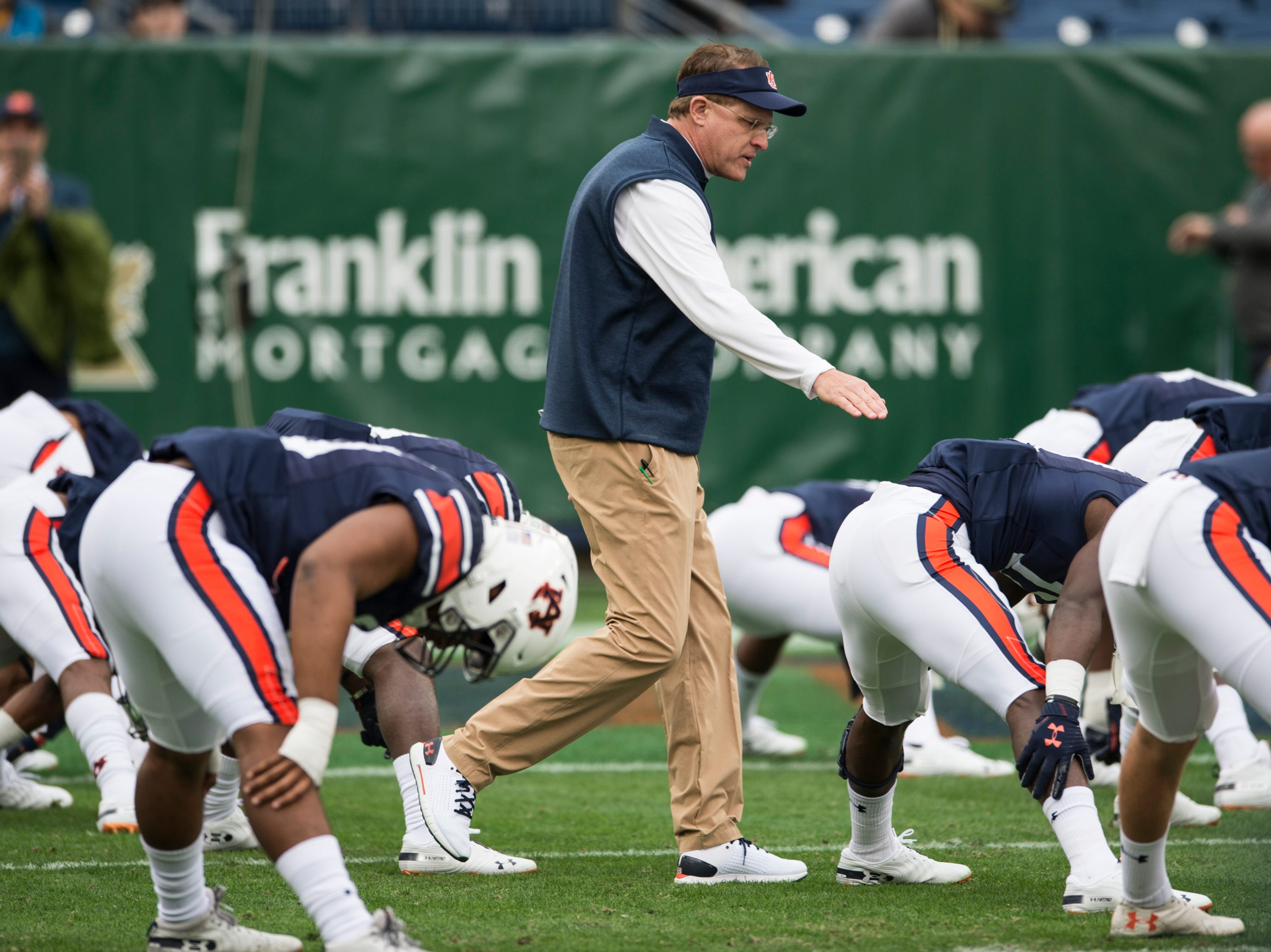 Auburn head coach Gus Malzahn acknowledges his players during warm ups before the Music City Bowl at Nissan Stadium in Nashville, Tenn., on Friday, Dec. 28, 2018.