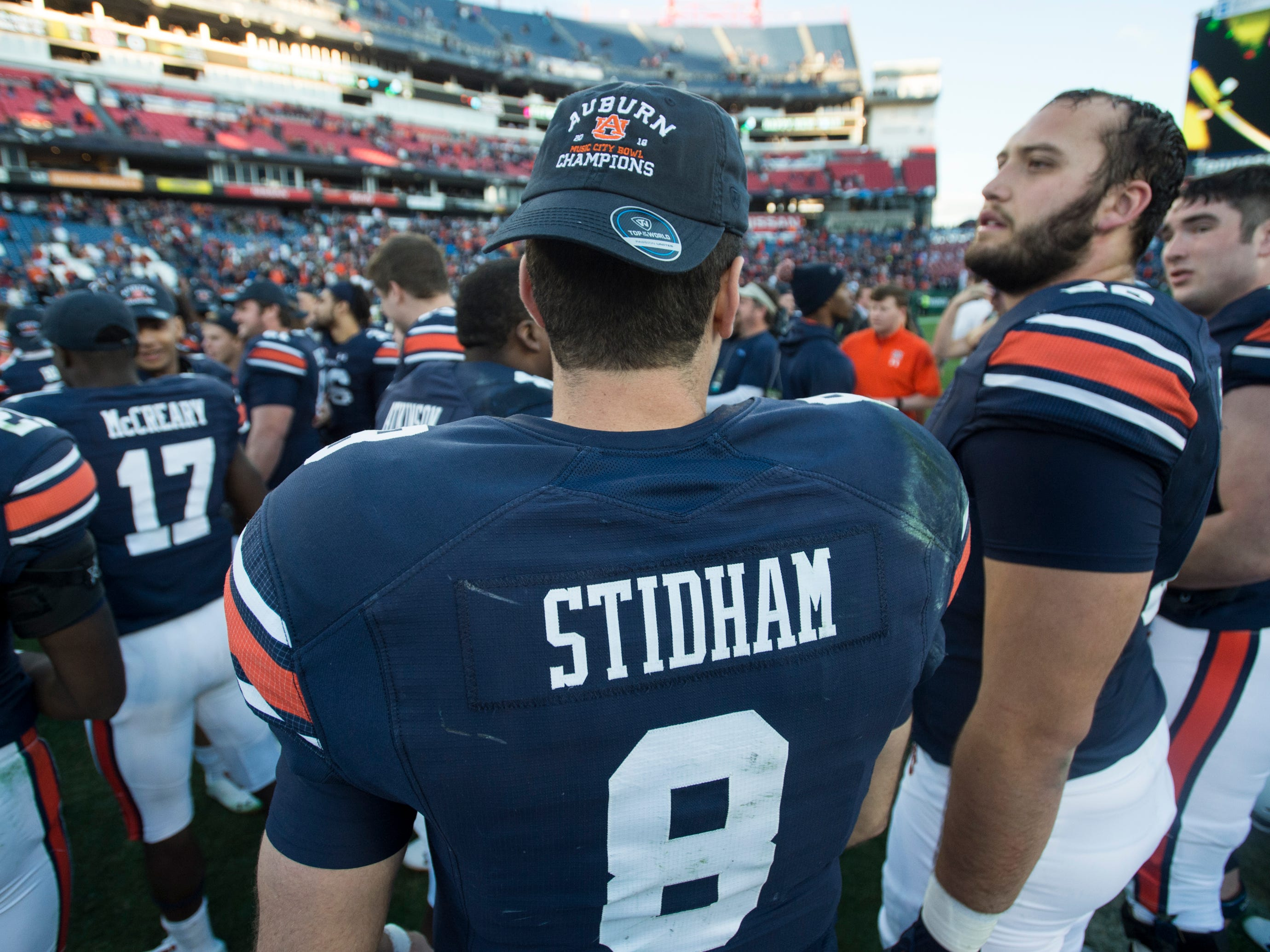 Auburn quarterback Jarrett Stidham (8) wears the champions hat after the Music City Bowl at Nissan Stadium in Nashville, Tenn., on Friday, Dec. 28, 2018. Auburn defeated Purdue 63-14.