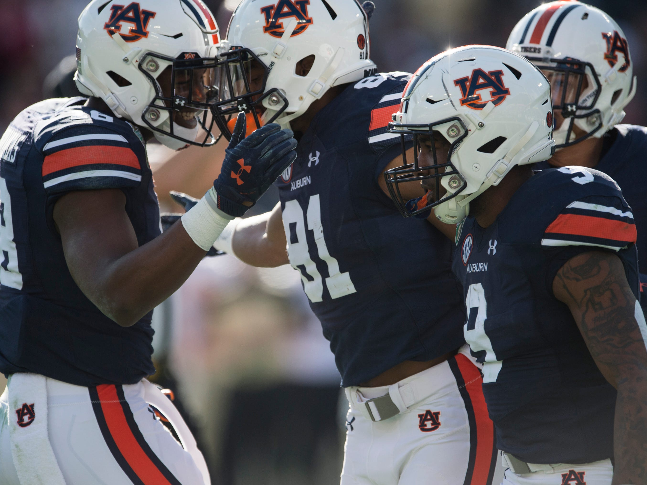 Auburn wide receiver Darius Slayton (81) celebrates his touchdown with teammates Seth Williams (18), Kam Martin (9) and Anthony Schwartz (5) during the Music City Bowl at Nissan Stadium in Nashville, Tenn., on Friday, Dec. 28, 2018.