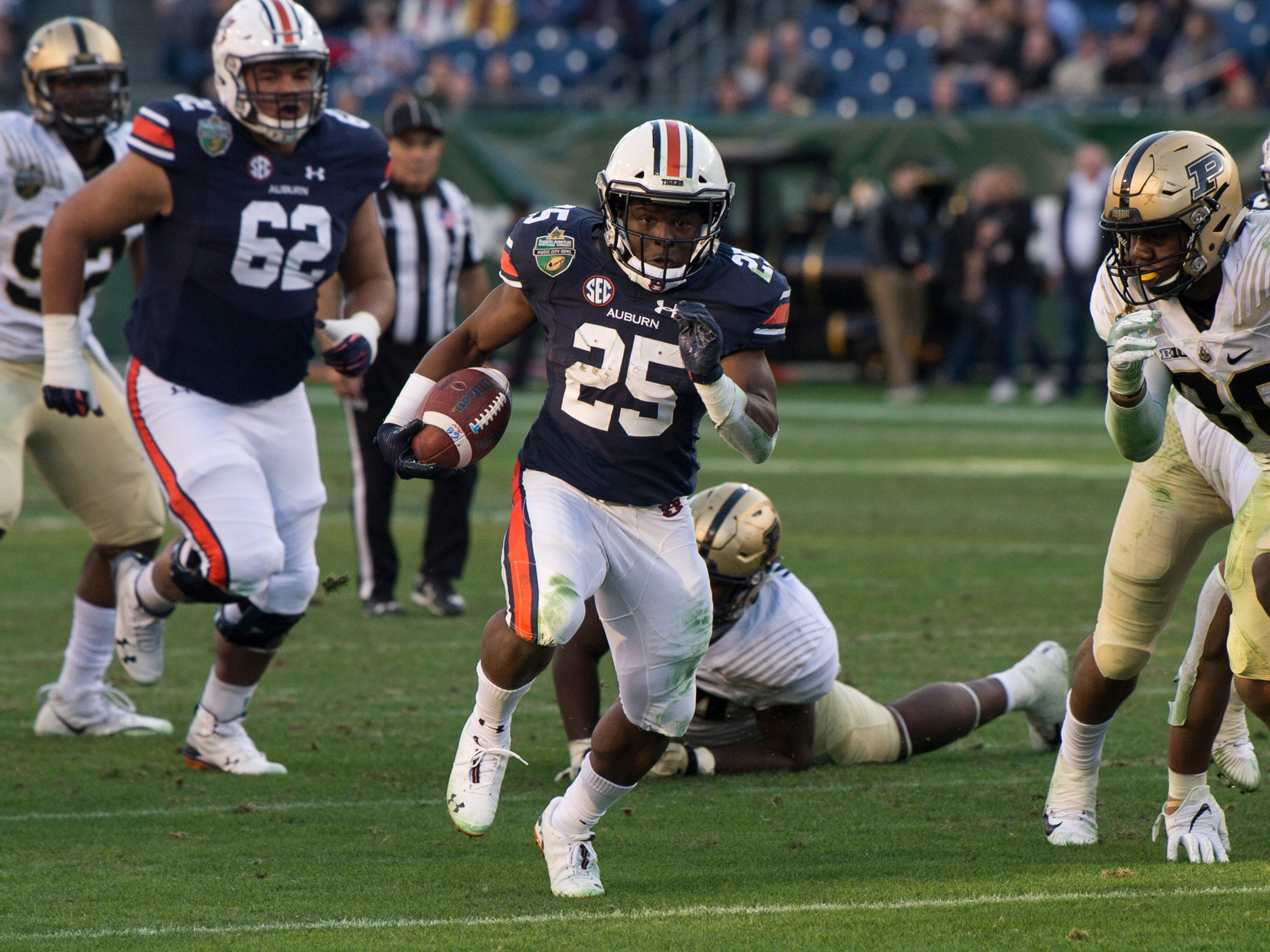 Auburn running back Shaun Shivers (25) runs the ball up the middle during the Music City Bowl at Nissan Stadium in Nashville, Tenn., on Friday, Dec. 28, 2018. Auburn defeated Purdue 63-14.