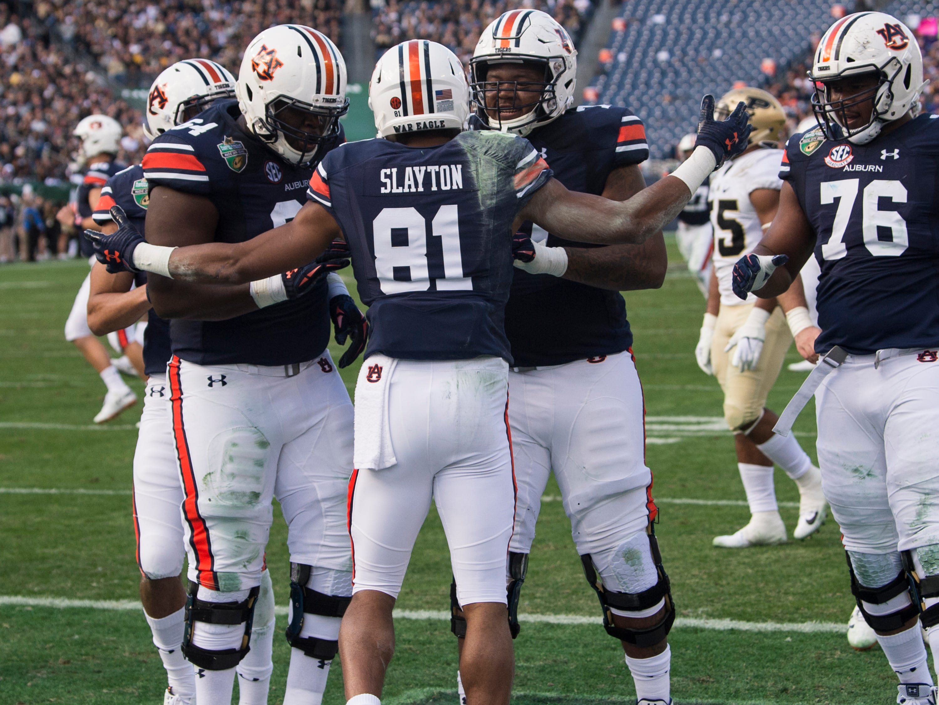 Auburn wide receiver Darius Slayton (81) celebrates with his team after catching a touchdown pass during the Music City Bowl at Nissan Stadium in Nashville, Tenn., on Friday, Dec. 28, 2018. Auburn leads Purdue 56-7 at halftime.