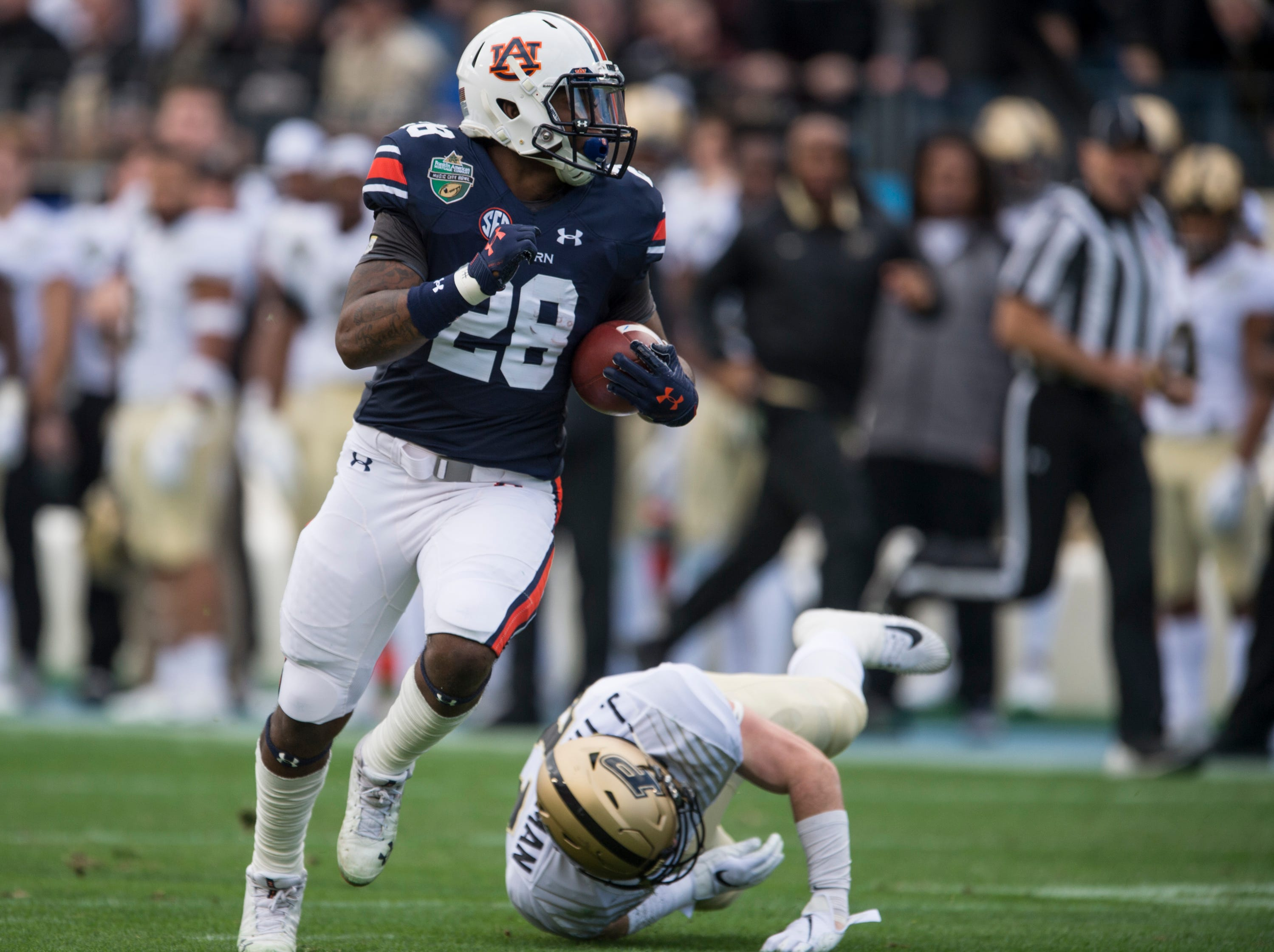 Auburn running back JaTarvious Whitlow (28) breaks free after catching the ball and runs it in for a touchdown during the Music City Bowl at Nissan Stadium in Nashville, Tenn., on Friday, Dec. 28, 2018. Auburn leads Purdue 56-7 at halftime.