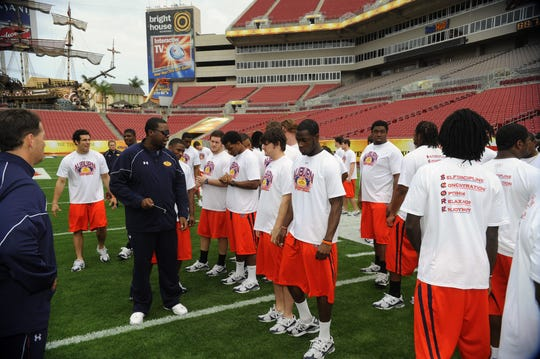 Special teams coach Jay Boulware talks to his players. Auburn had a walk through and the Outback Bowl team picture Thursday. Auburn football Outback Bowl in Tampa on Thursday, Dec. 31, 2009 in Tampa, FL.