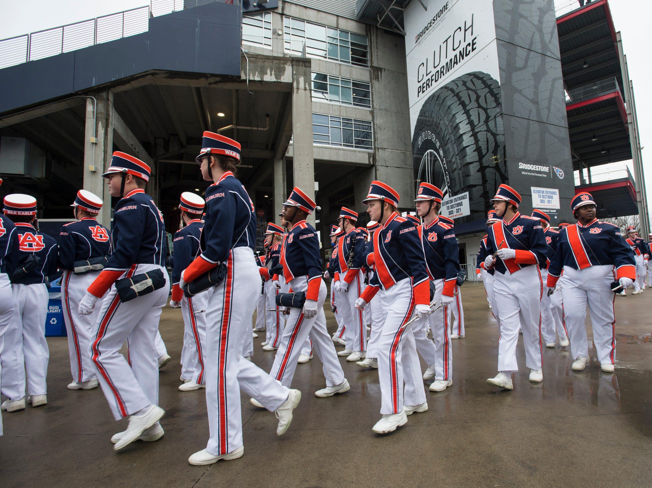 Auburn Marching band arrives at Nissan Stadium in Nashville, Tenn., on Friday, Dec. 28, 2018.