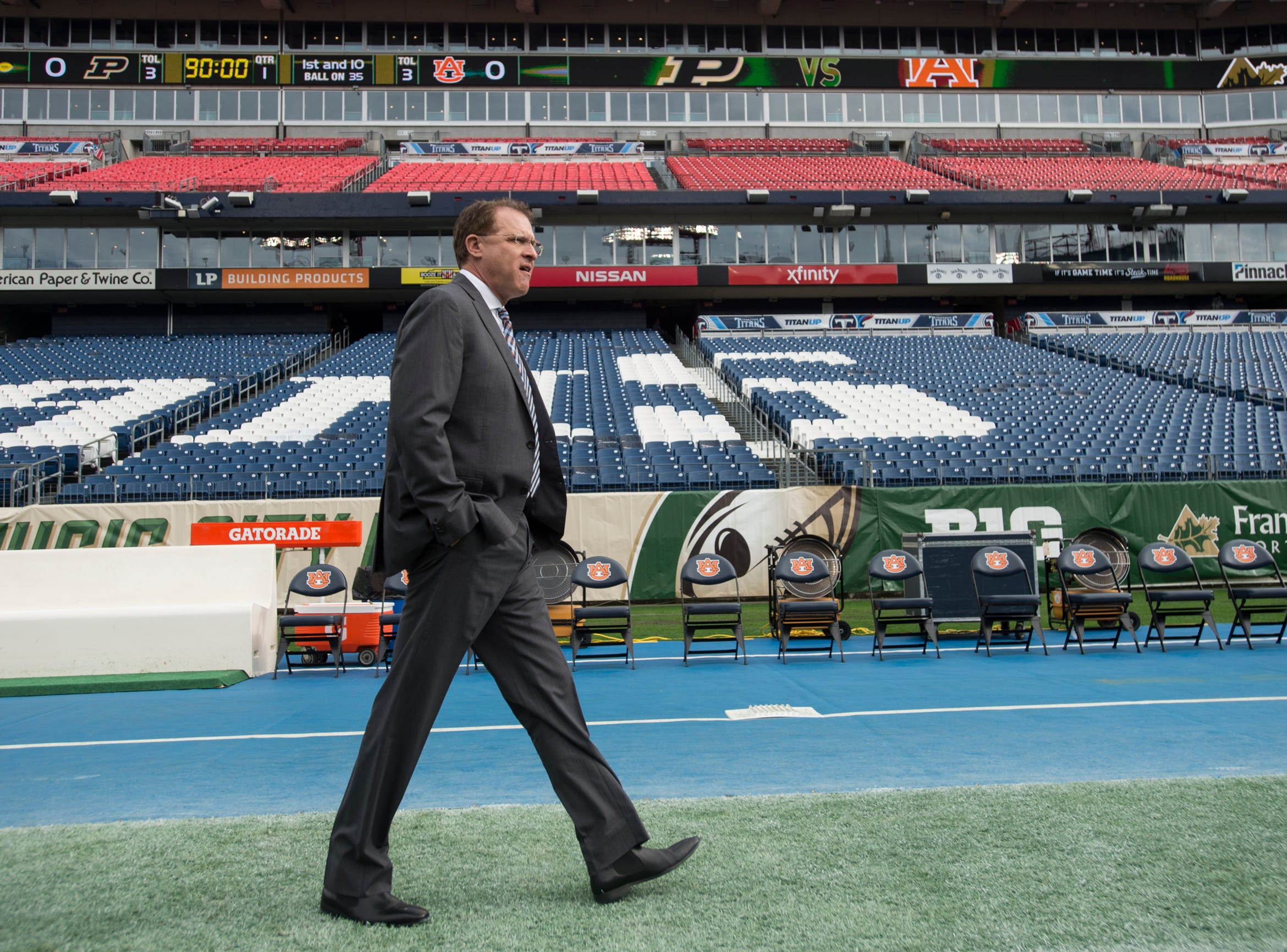 Auburn head coach Gus Malzahn walks the field before taking on Purdue in the Music City Bowl at Nissan Stadium in Nashville, Tenn., on Friday, Dec. 28, 2018.