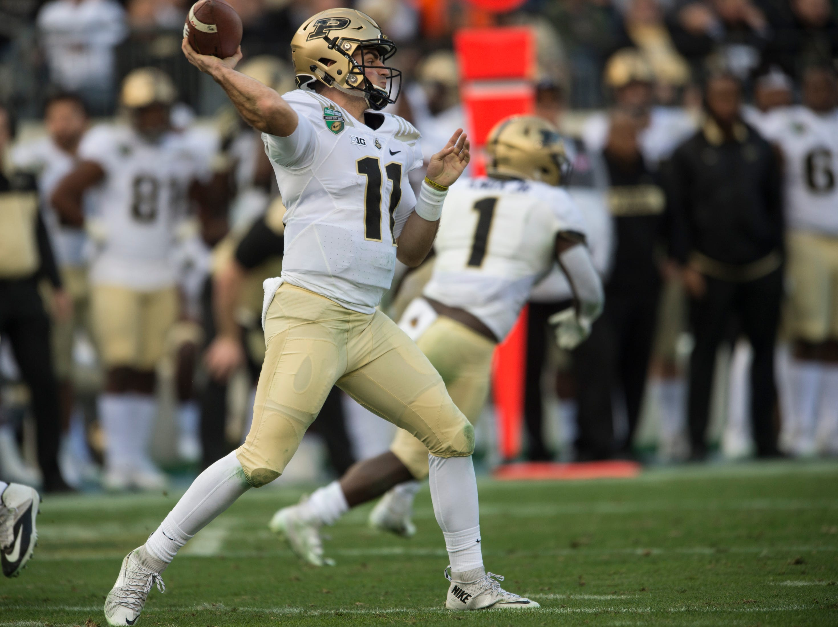 Purdue quarterback David Blough (11) throws the ball down the field during the Music City Bowl at Nissan Stadium in Nashville, Tenn., on Friday, Dec. 28, 2018. Auburn leads Purdue 56-7 at halftime.