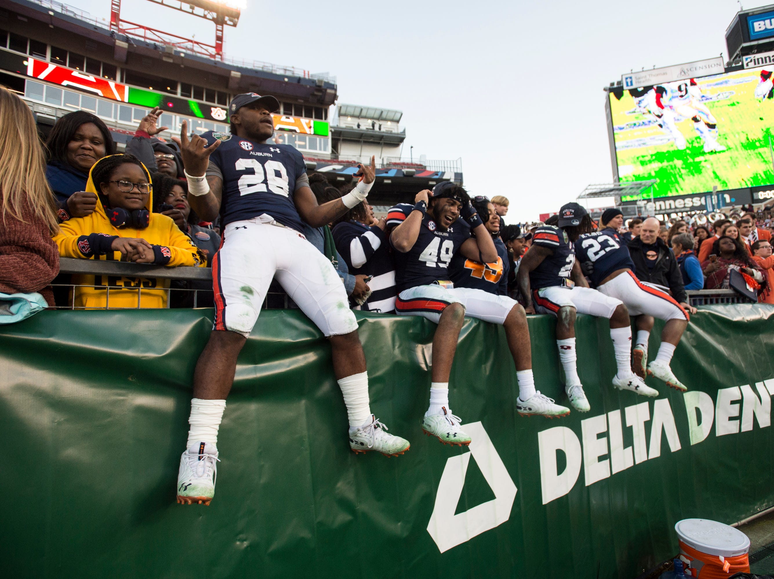 Auburn players join the fans after the Music City Bowl at Nissan Stadium in Nashville, Tenn., on Friday, Dec. 28, 2018. Auburn defeated Purdue 63-14.