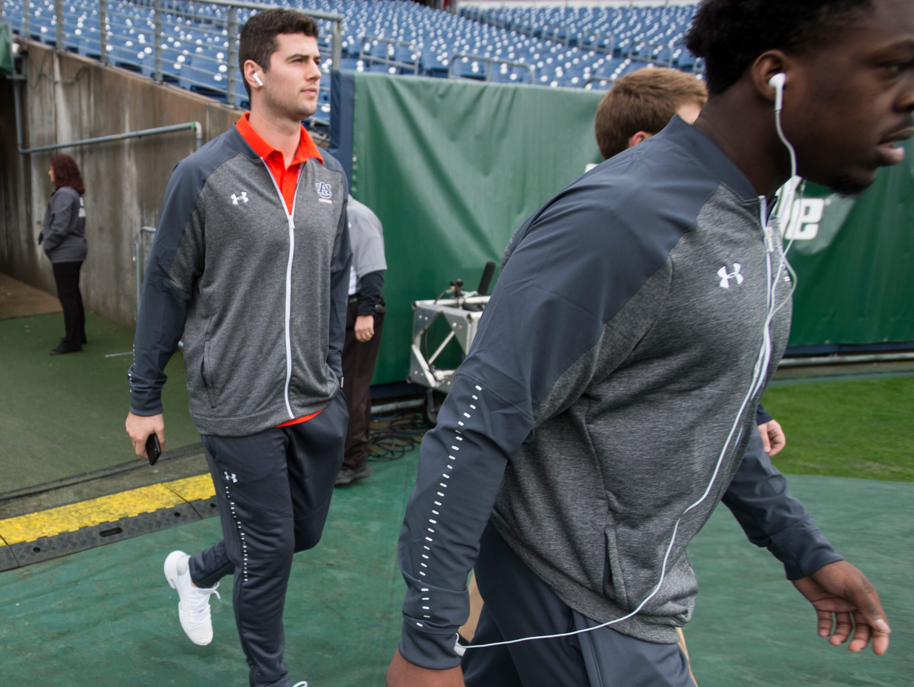 Auburn quarterback Jarrett Stidham (8) walks the field before taking on Purdue in the Music City Bowl at Nissan Stadium in Nashville, Tenn., on Friday, Dec. 28, 2018.