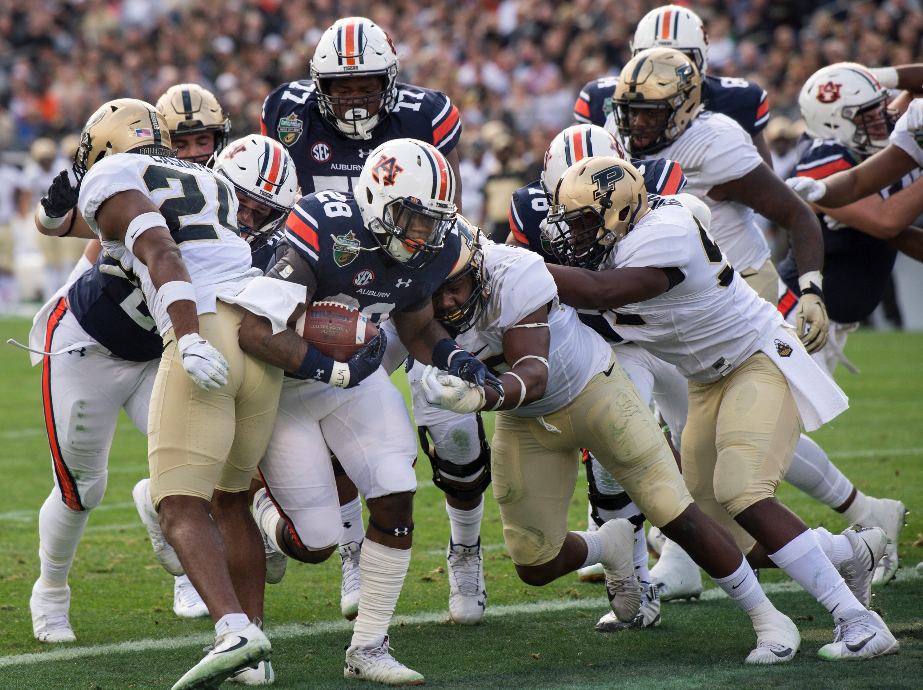 Auburn running back JaTarvious Whitlow (28) powers his way into the end zone for a touchdown during the Music City Bowl at Nissan Stadium in Nashville, Tenn., on Friday, Dec. 28, 2018. Auburn defeated Purdue 63-14.