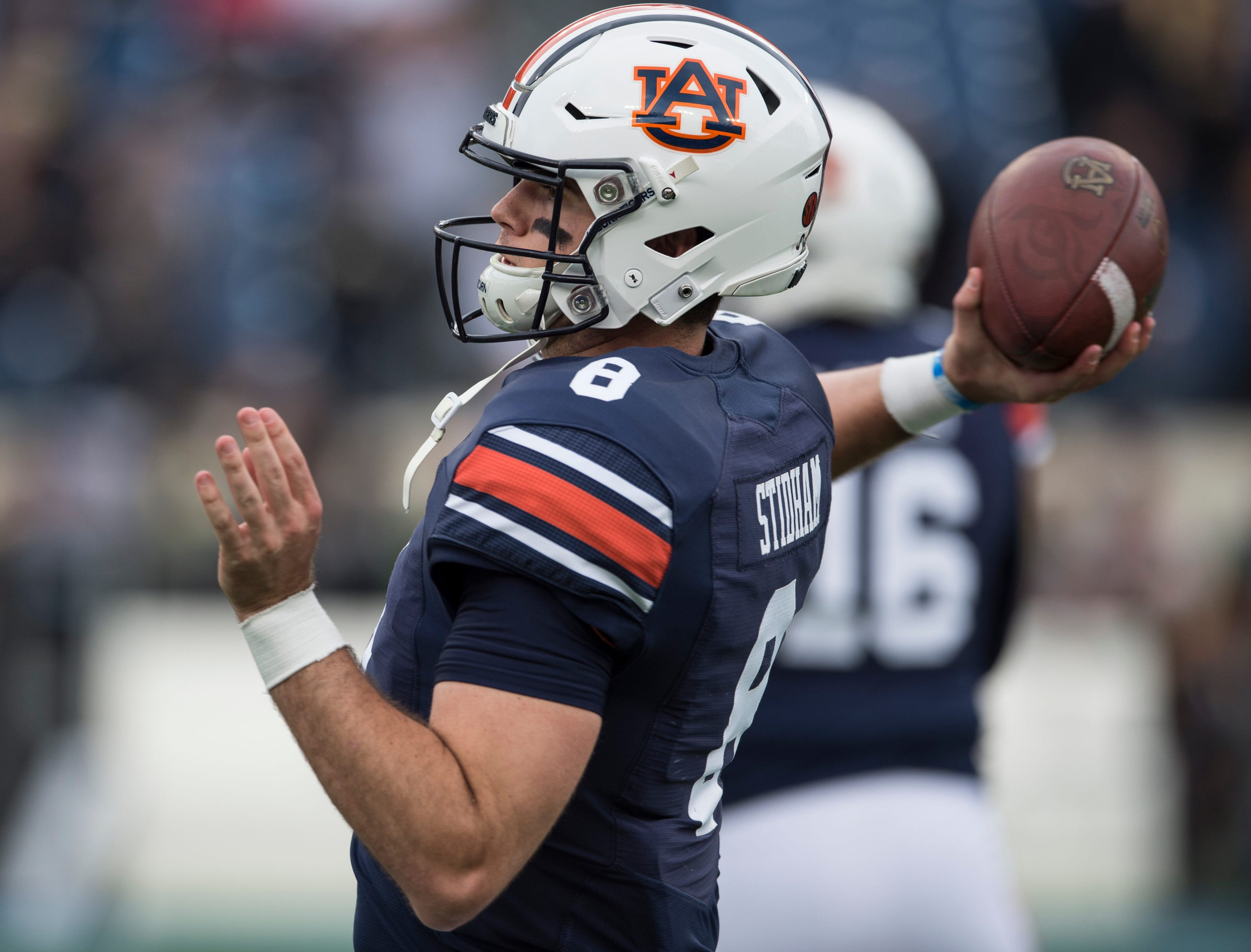 Auburn quarterback Jarrett Stidham (8) warms up before the Music City Bowl at Nissan Stadium in Nashville, Tenn., on Friday, Dec. 28, 2018.