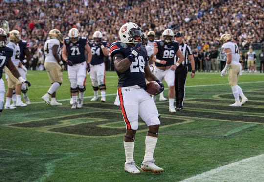 Auburn running back JaTarvious Whitlow (28) celebrates a touchdown run during the Music City Bowl at Nissan Stadium in Nashville, Tenn., on Friday, Dec. 28, 2018. Auburn defeated Purdue 63-14.