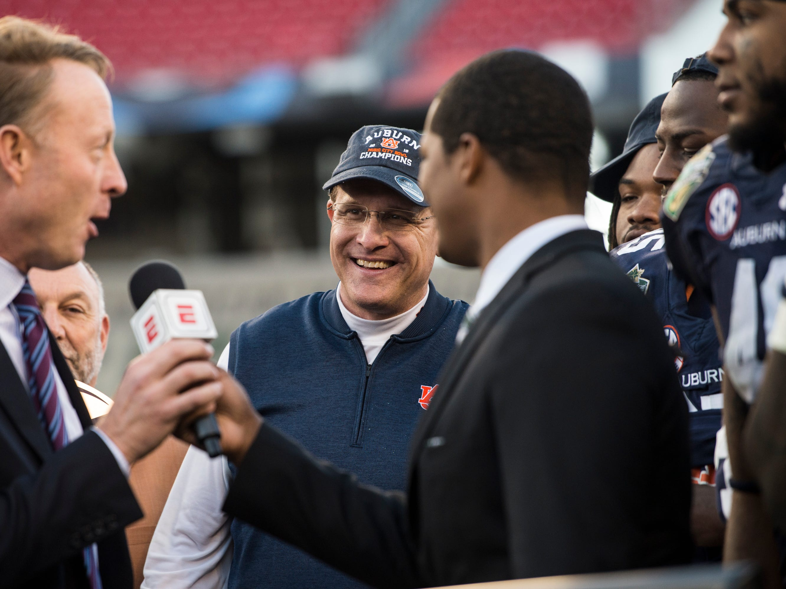 Auburn head coach Gus Malzahn smiles as his team is awarded the trophy after winning the Music City Bowl at Nissan Stadium in Nashville, Tenn., on Friday, Dec. 28, 2018. Auburn defeated Purdue 63-14.
