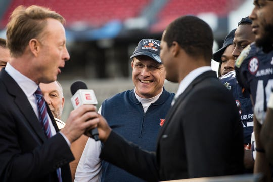 Auburn head coach Gus Malzahn smiles as his team is awarded the trophy after winning the Music City Bowl at Nissan Stadium in Nashville, Tenn., on Friday, Dec. 28, 2018. Auburn defeated Purdue 63-14.