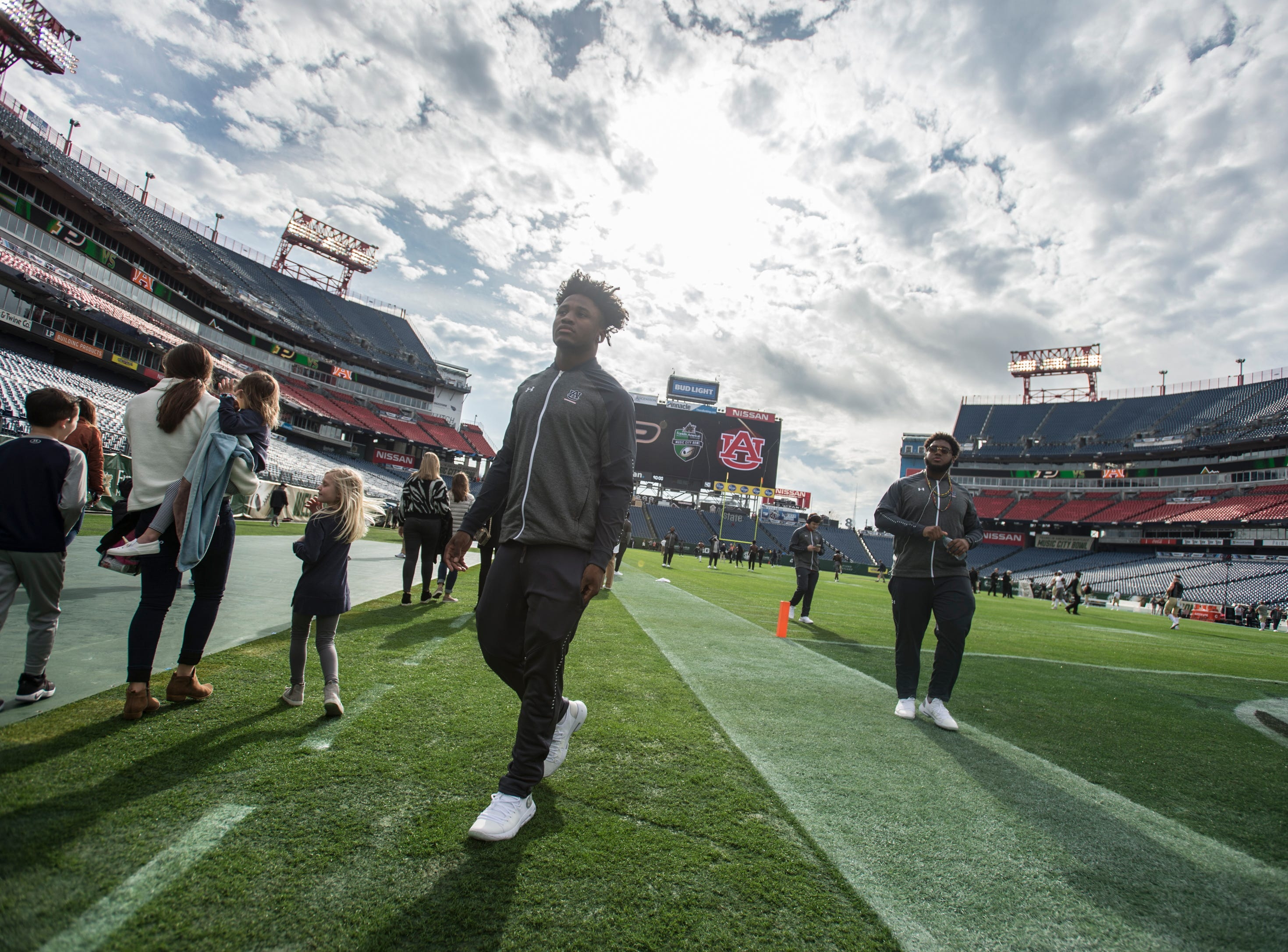 Auburn players walk the field before taking on Purdue in the Music City Bowl at Nissan Stadium in Nashville, Tenn., on Friday, Dec. 28, 2018.