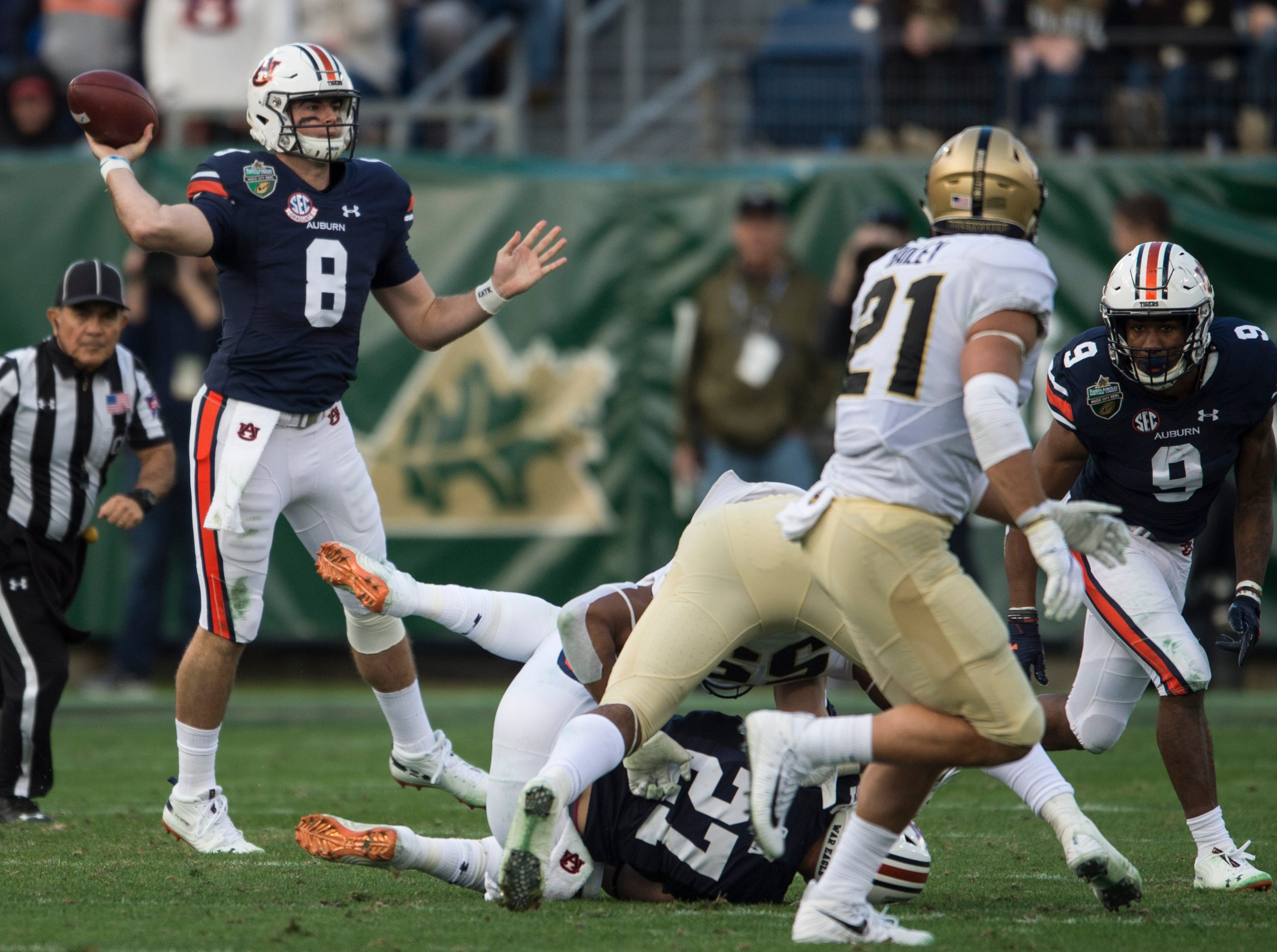 Auburn quarterback Jarrett Stidham (8) throws the ball down the field during the Music City Bowl at Nissan Stadium in Nashville, Tenn., on Friday, Dec. 28, 2018. Auburn leads Purdue 56-7 at halftime.