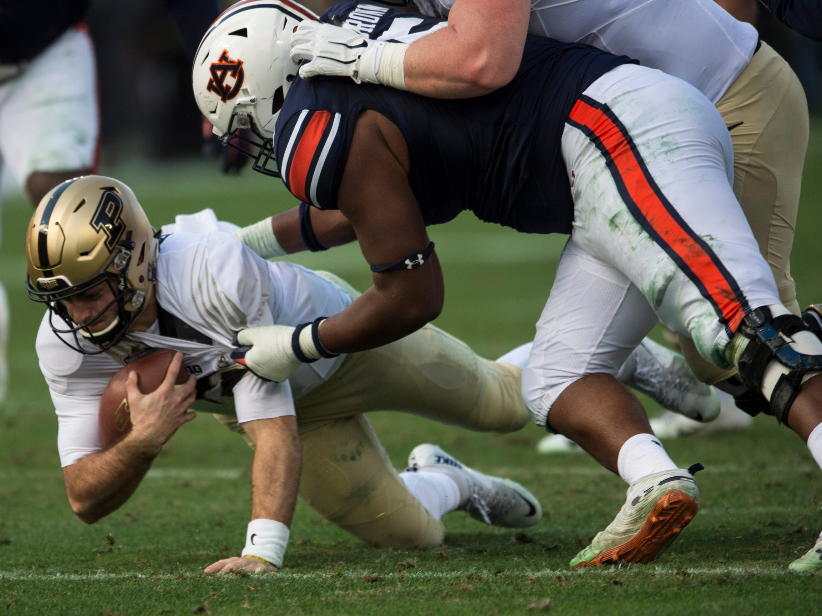 Auburn defensive lineman Derrick Brown (5) drags down Purdue quarterback David Blough (11) during the Music City Bowl at Nissan Stadium in Nashville, Tenn., on Friday, Dec. 28, 2018. Auburn defeated Purdue 63-14.