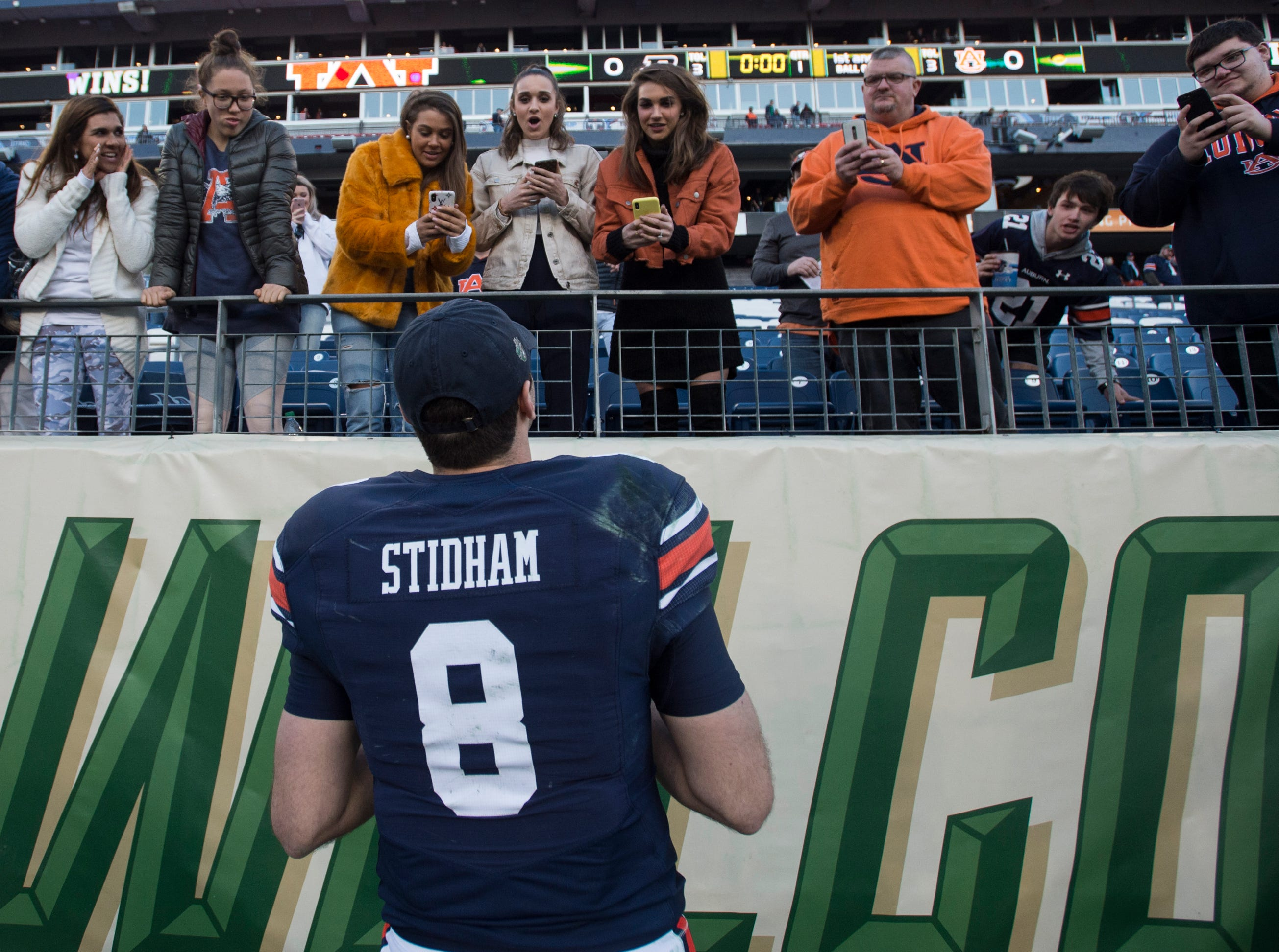 Auburn quarterback Jarrett Stidham (8) talks with family and fans at the end of the game after the Music City Bowl at Nissan Stadium in Nashville, Tenn., on Friday, Dec. 28, 2018. Auburn defeated Purdue 63-14.