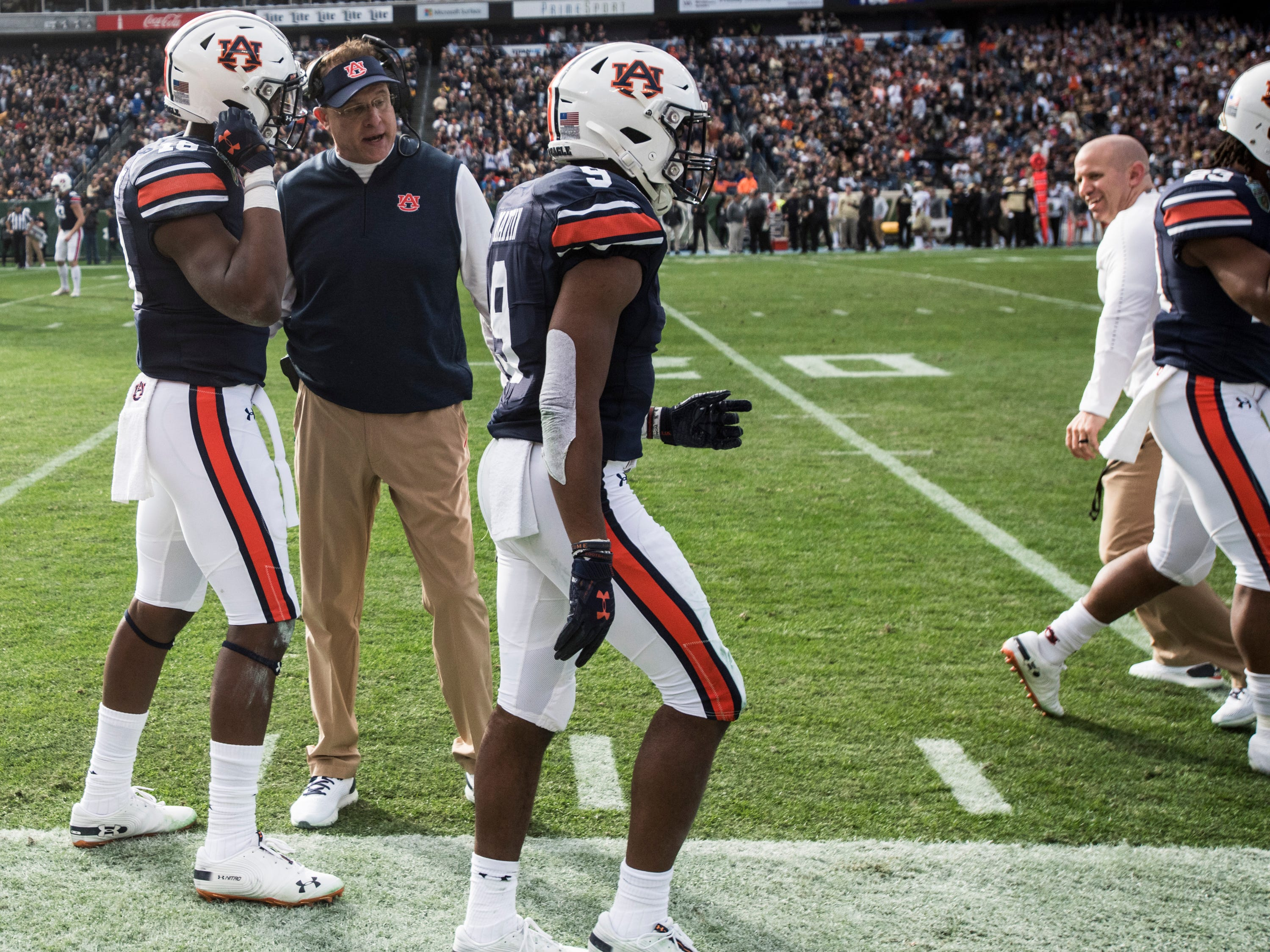 Auburn head coach Gus Malzahn talks with Auburn wide receiver Seth Williams (18) after a touchdown during the Music City Bowl at Nissan Stadium in Nashville, Tenn., on Friday, Dec. 28, 2018. Auburn leads Purdue 56-7 at halftime.