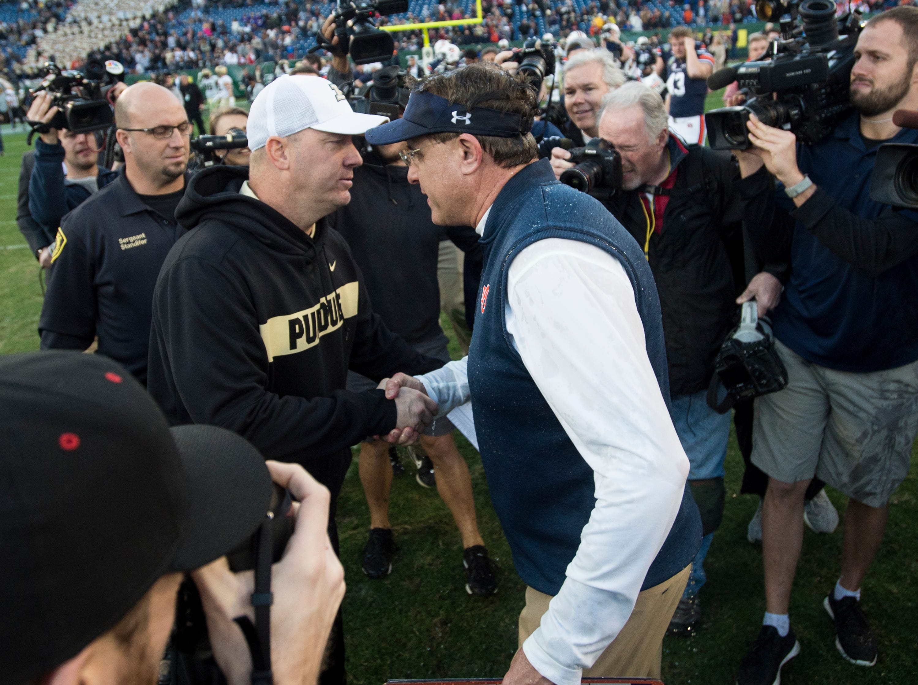 Purdue head coach Jeff Brohm and Auburn head coach Gus Malzahn shake hands after the Music City Bowl at Nissan Stadium in Nashville, Tenn., on Friday, Dec. 28, 2018. Auburn defeated Purdue 63-14.