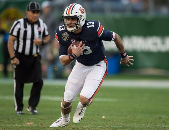 Auburn quarterback Joey Gatewood (13) runs the ball during the Music City Bowl at Nissan Stadium in Nashville, Tenn., on Friday, Dec. 28, 2018. Auburn defeated Purdue 63-14.