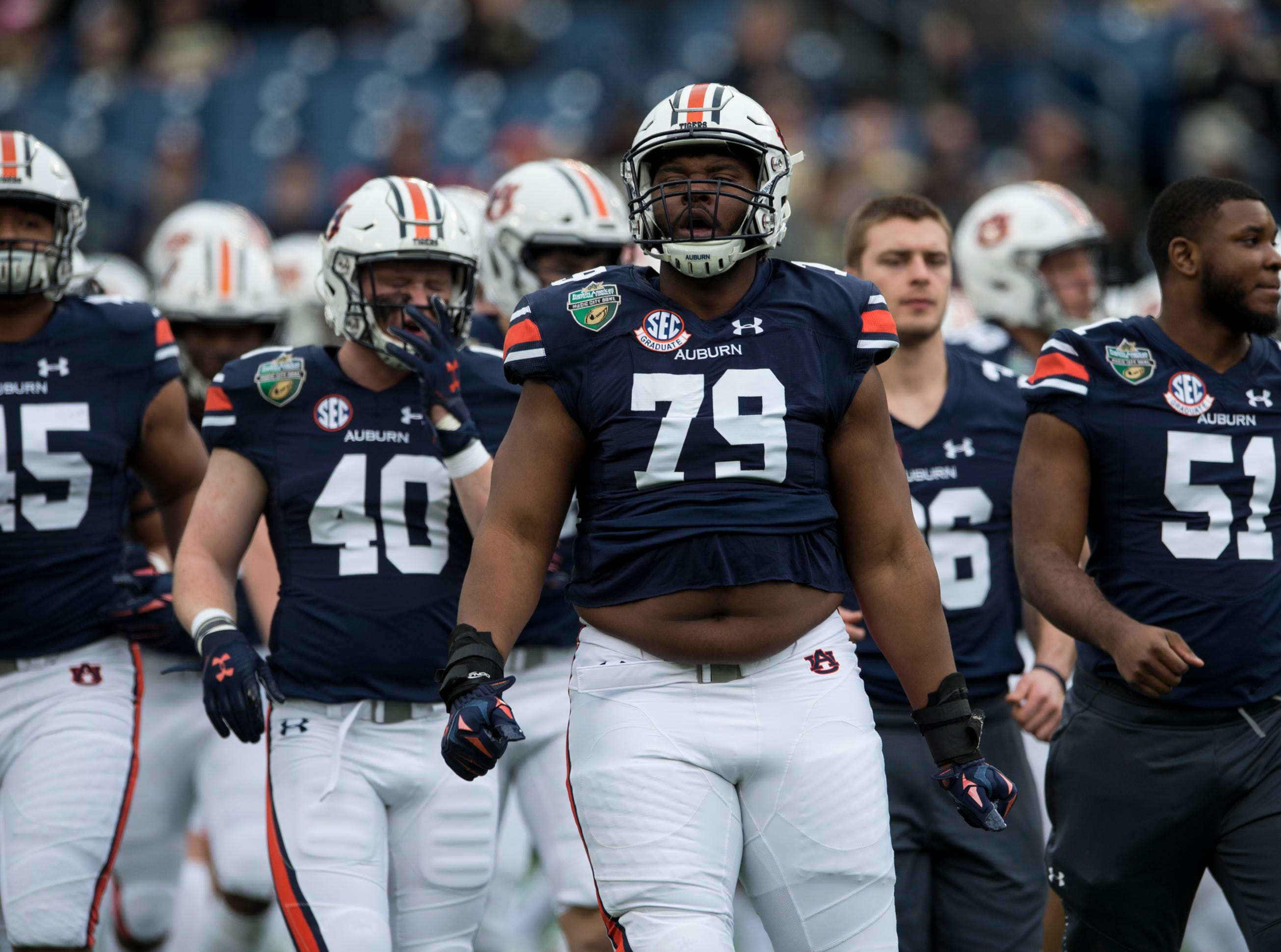 Auburn players get pumped up before the Music City Bowl at Nissan Stadium in Nashville, Tenn., on Friday, Dec. 28, 2018.