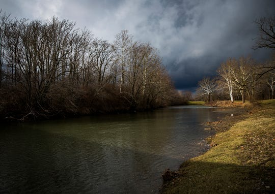 The White River flows adjacent to the Indiana Steel & Wire clean up site on E. Jackson Street in Muncie Friday morning.