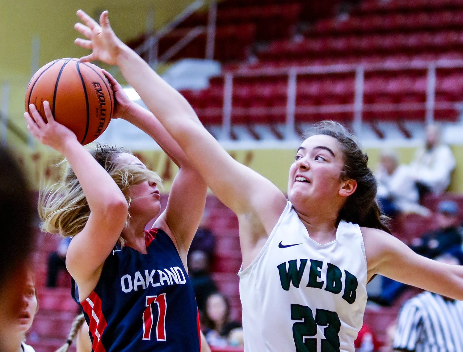 Oakland's Claira McGowan goes for a shot as Webb's Catherine Hendershot defends.