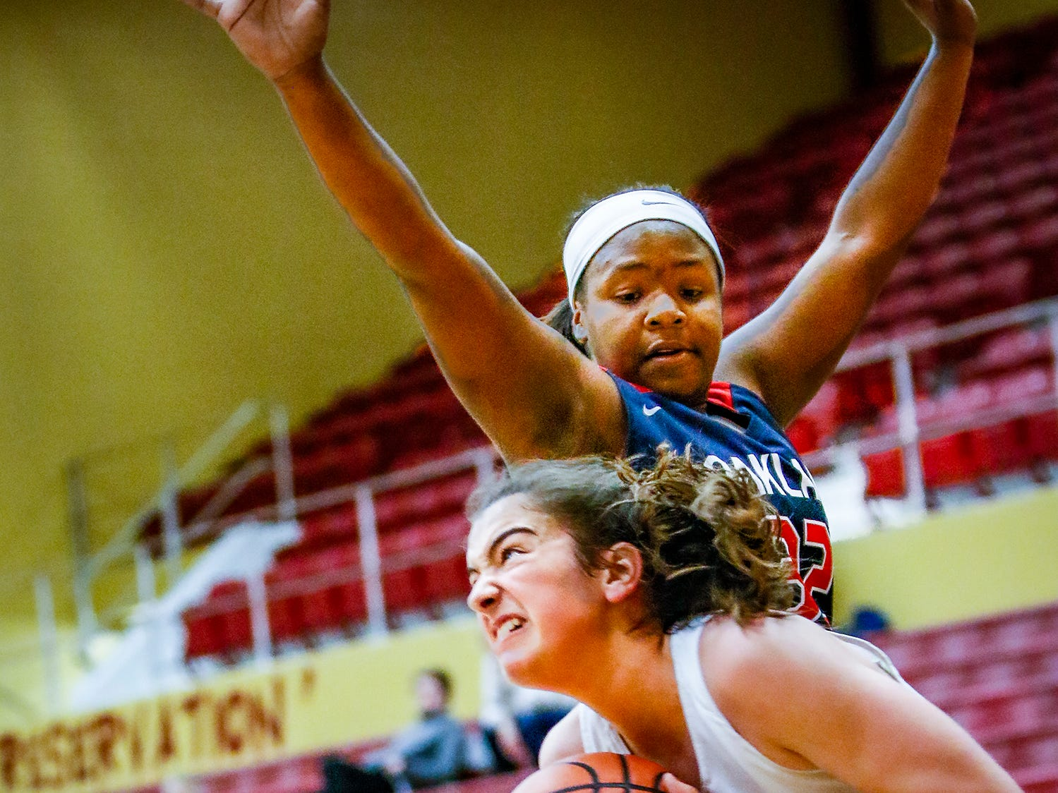Webb's Catherine Hendershot tries to get to the basket as Oakland's Erica Collier defends.