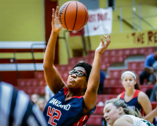 Oakland's Nicole Egeruoh pulls down a rebound during a recent game. Egeruoh scored 21 points as the Lady Patriots knocked off Blackman 50-49 Tuesday.