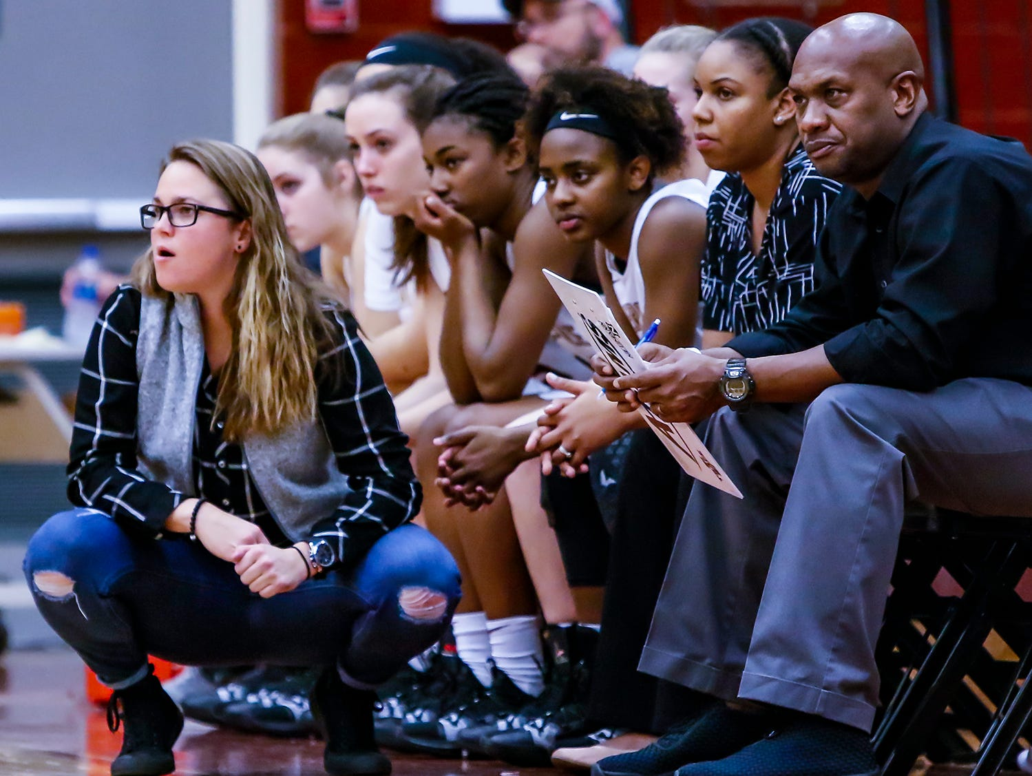 Riverdale coach Amy Josephson (kneeling) watches State Farm Classic action Thursday.
