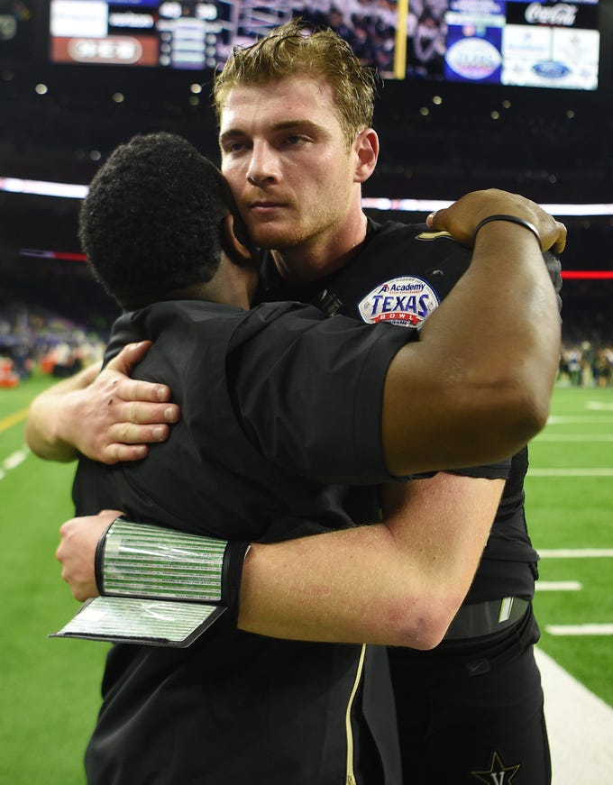 Vanderbilt Commodores head coach Derek Mason hugs quarterback Kyle Shurmur (14) after the team's 45-38 loss to Baylor in the Academy Sports + Outdoors Texas Bowl at NRG Stadium in Houston on Thursday, Dec. 27, 2018.