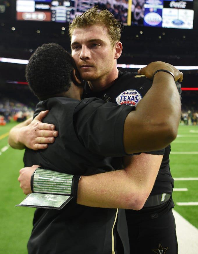 Vanderbilt Commodores head coach Derek Mason hugs quarterback Kyle Shurmur (14) after the team's 45-38 loss to Baylor in the Academy Sports + Outdoors Texas Bowl at NRG Stadium in Houston on Thursday, Dec. 27, 2018.