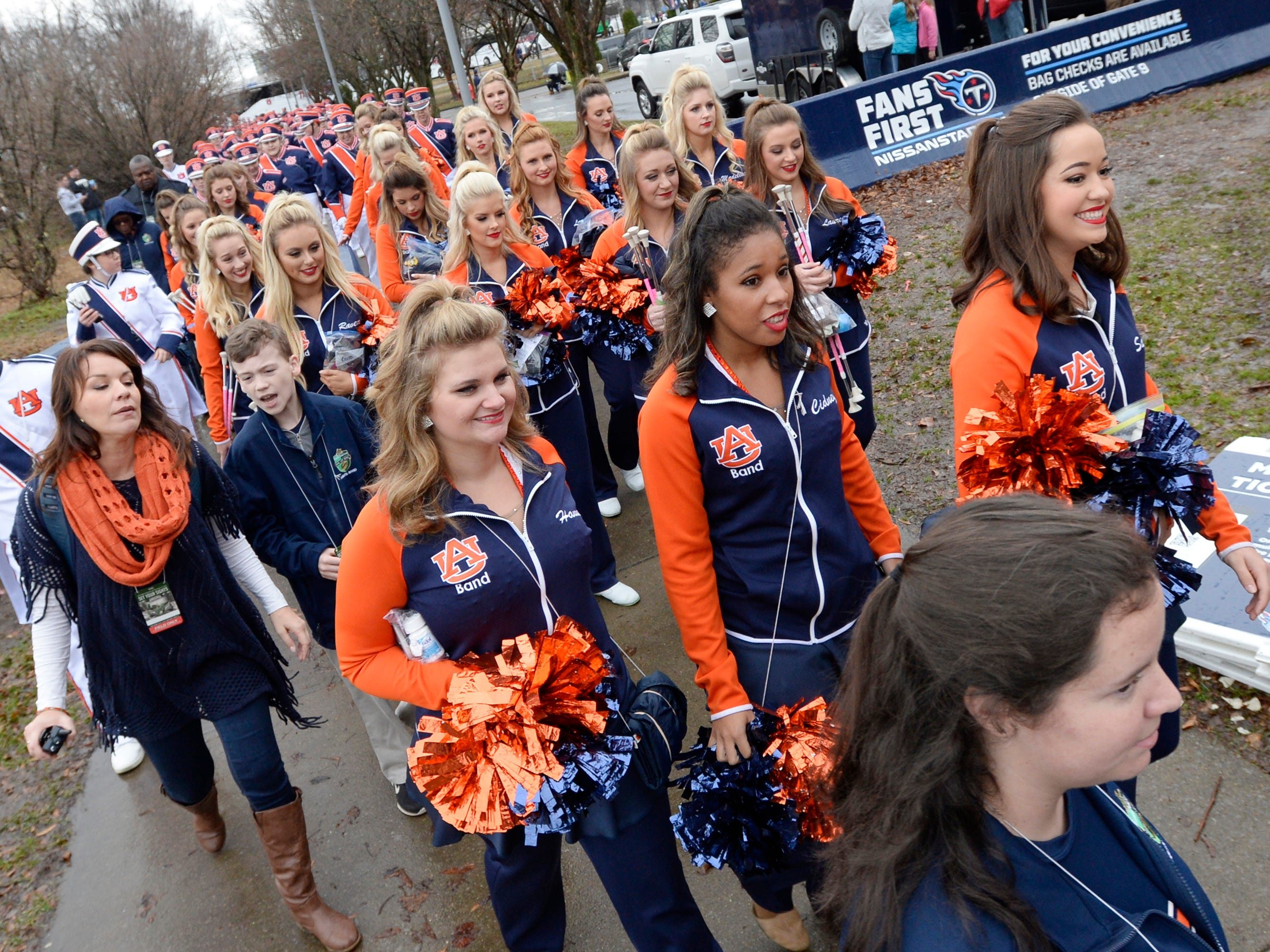 Auburn cheerleaders and band arrive for the Music City Bowl NCAA college football game Friday, Dec. 28, 2018, at Nissan Stadium in Nashville, Tenn.