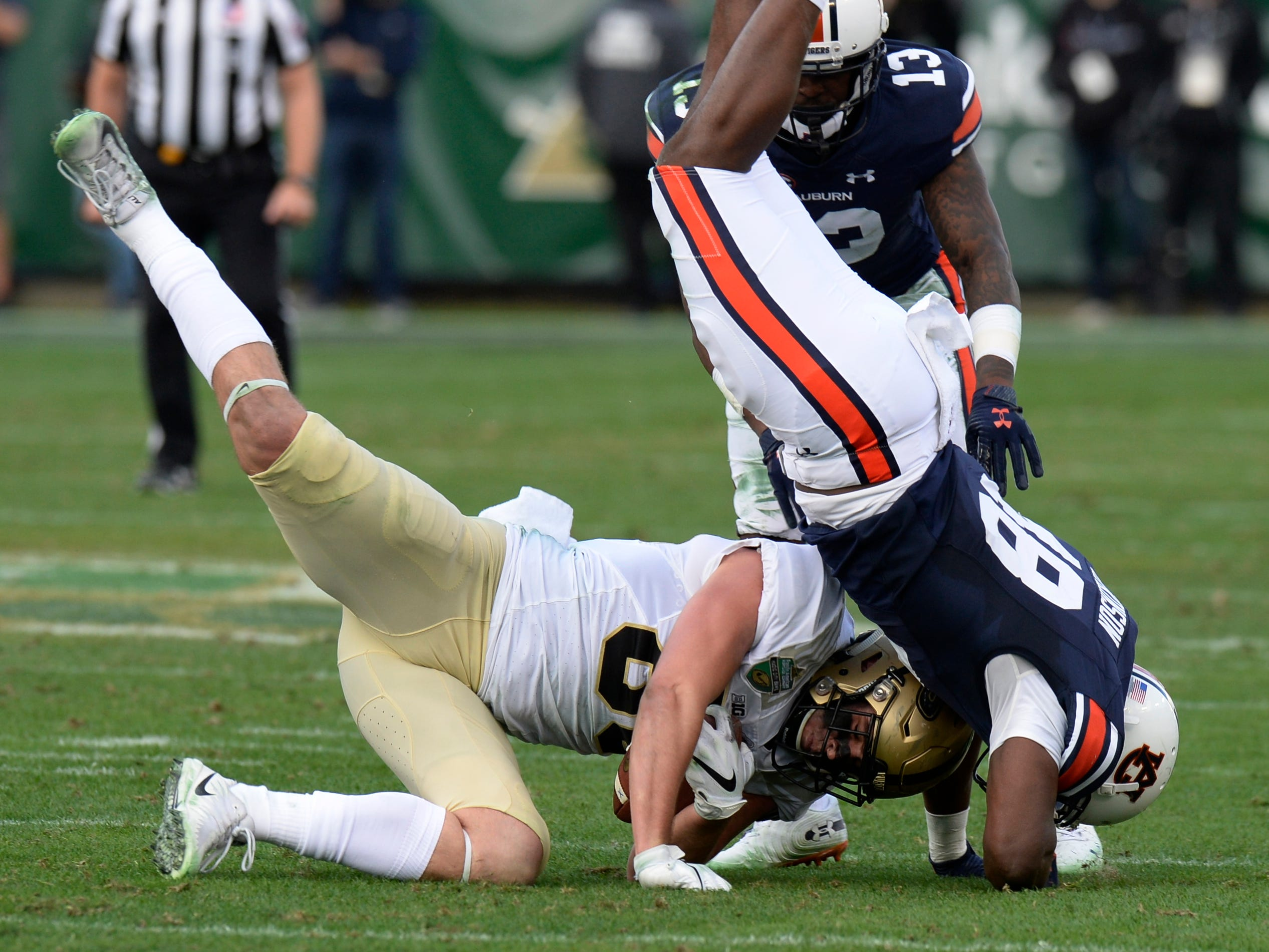 Purdue tight end Brycen Hopkins (89) catches a pass as he is tackled by Auburn linebacker Montavious Atkinson (48) in the second quarter of the Music City Bowl NCAA college football game Friday, Dec. 28, 2018, at Nissan Stadium in Nashville, Tenn.