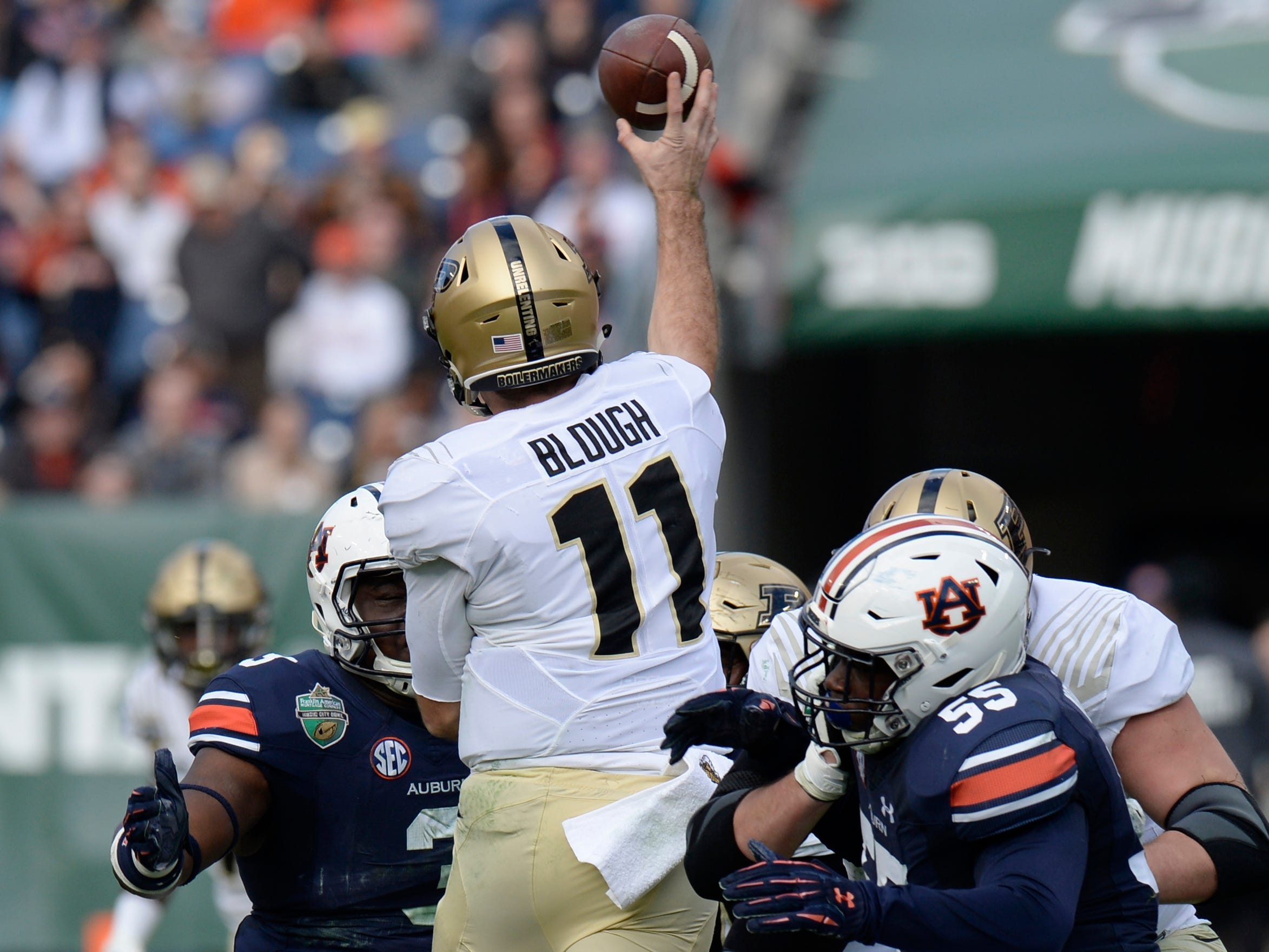Auburn defenders close in on Purdue quarterback David Blough (11) in the second quarter of the Music City Bowl NCAA college football game Friday, Dec. 28, 2018, at Nissan Stadium in Nashville, Tenn.