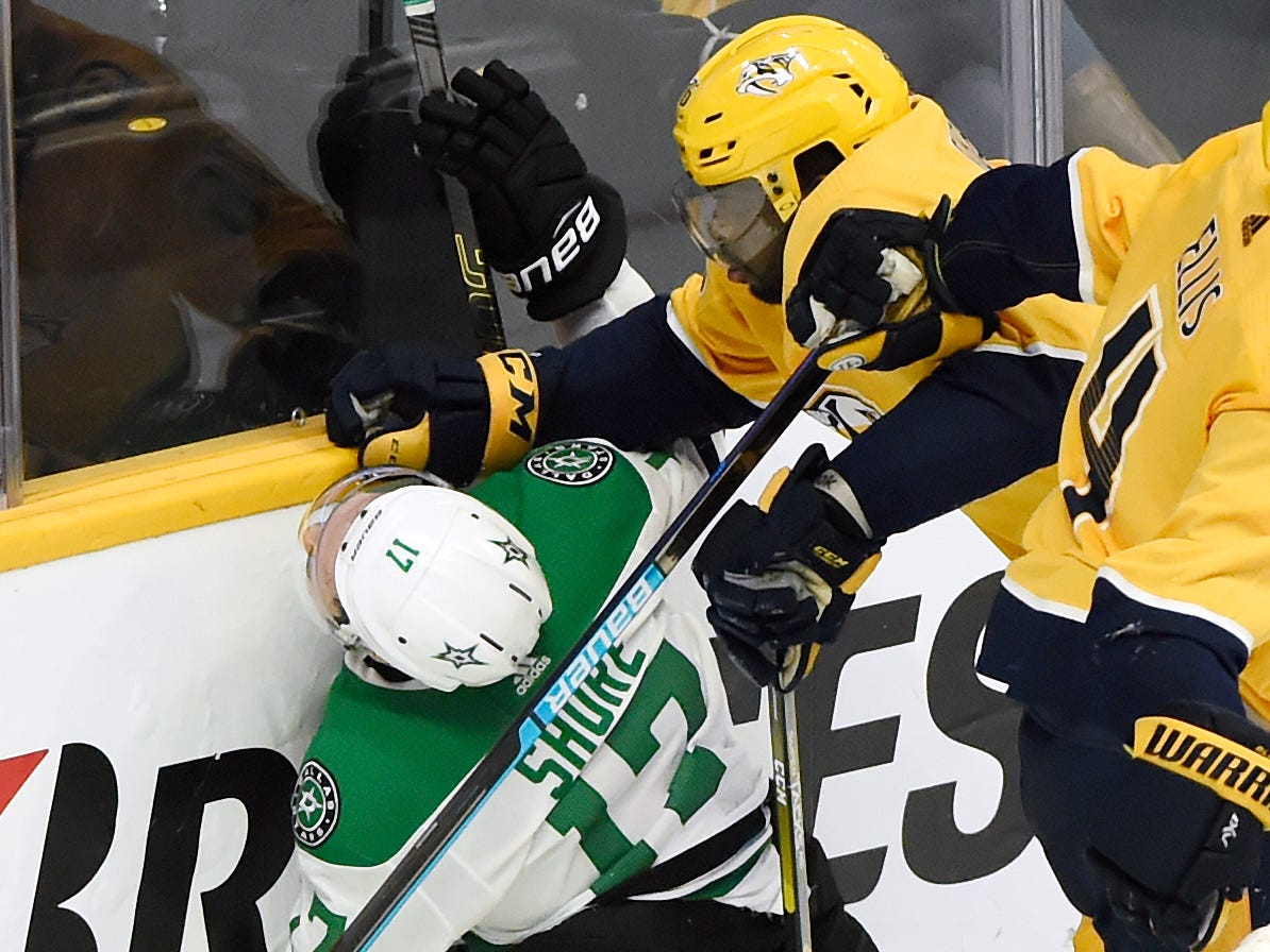 Nashville Predators defenseman P.K. Subban, top, checks Dallas Stars center Devin Shore (17) into the boards during the second period of an NHL hockey game Thursday, Dec. 27, 2018, in Nashville, Tenn. The Stars won 2-0.