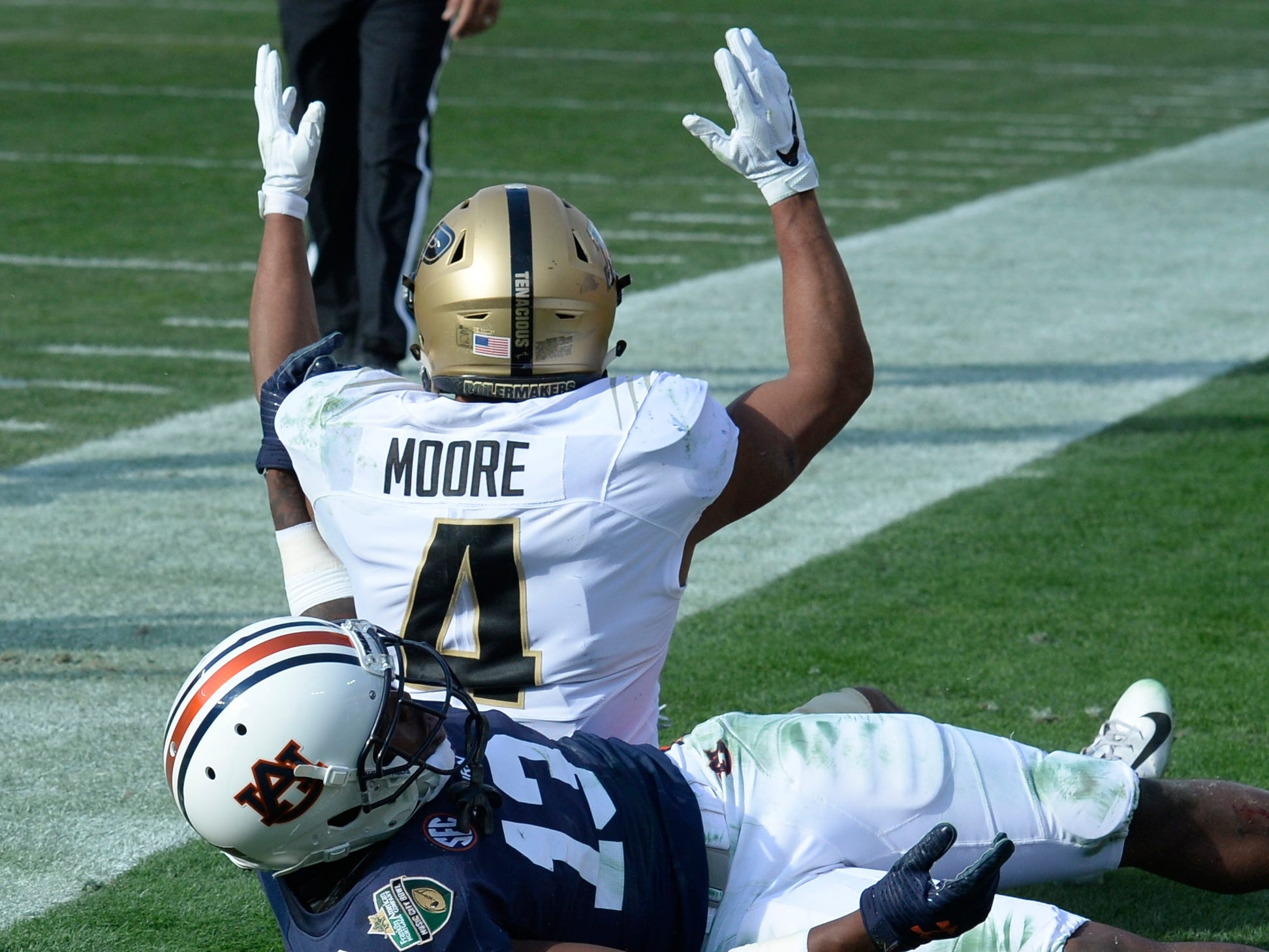 Purdue wide receiver Rondale Moore (4) motions for a touchdown to the referee in the first quarter of the Music City Bowl NCAA college football game Friday, Dec. 28, 2018, at Nissan Stadium in Nashville, Tenn.