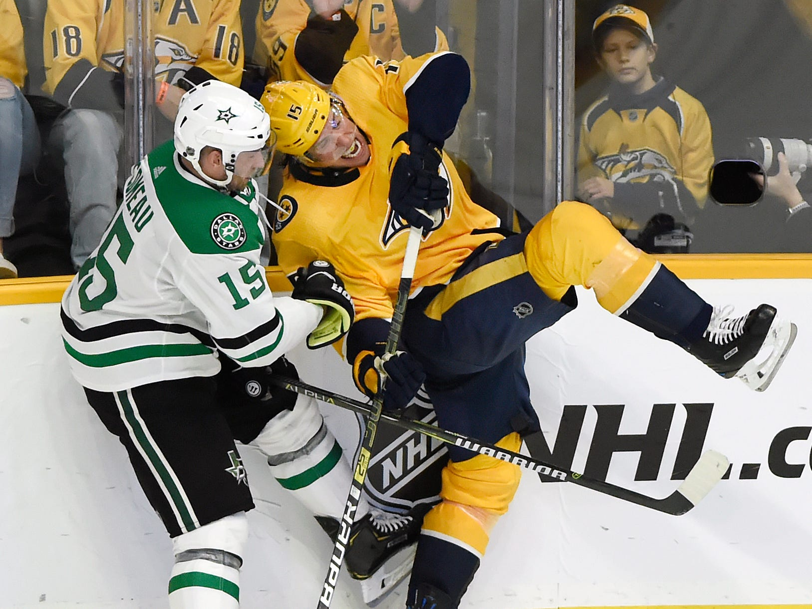 Dallas Stars left wing Blake Comeau, left, collides with Nashville Predators right wing Craig Smith during the third period of an NHL hockey game Thursday, Dec. 27, 2018, in Nashville, Tenn. The Stars won 2-0.