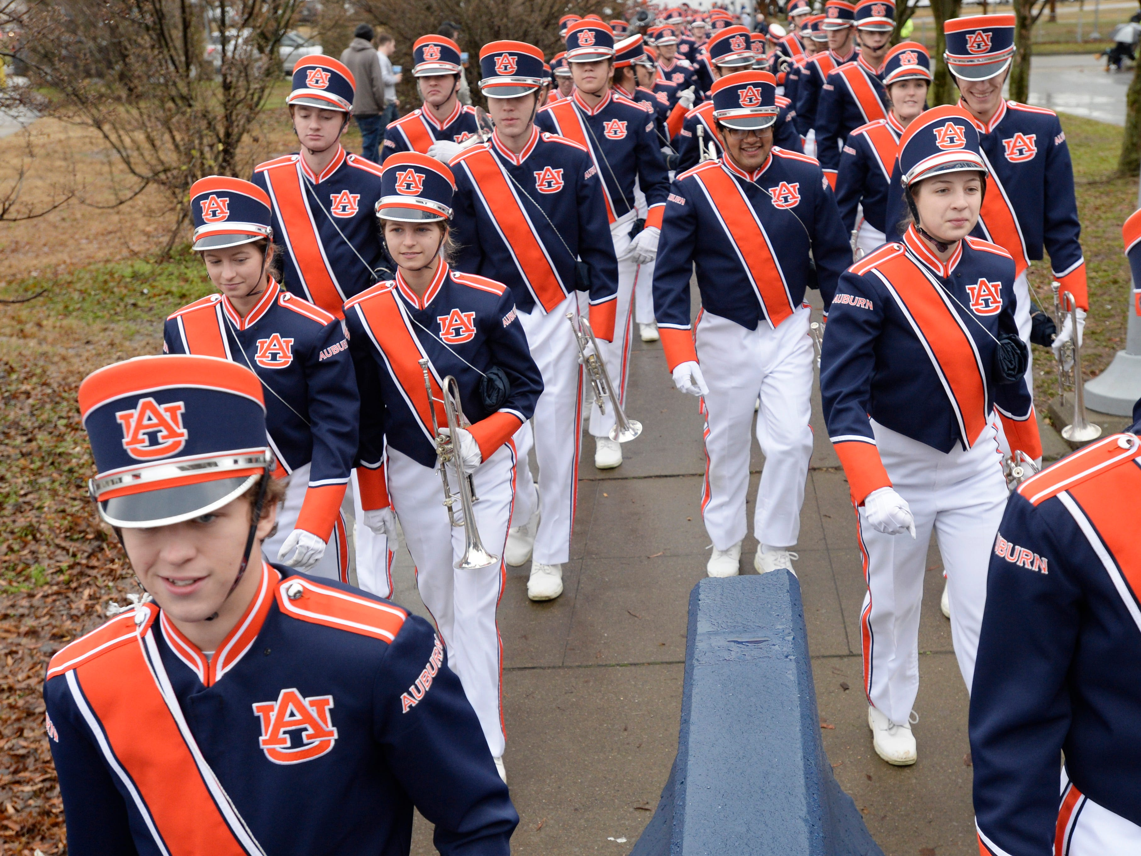 Auburn band members arrive for the Music City Bowl NCAA college football game Friday, Dec. 28, 2018, at Nissan Stadium in Nashville, Tenn.
