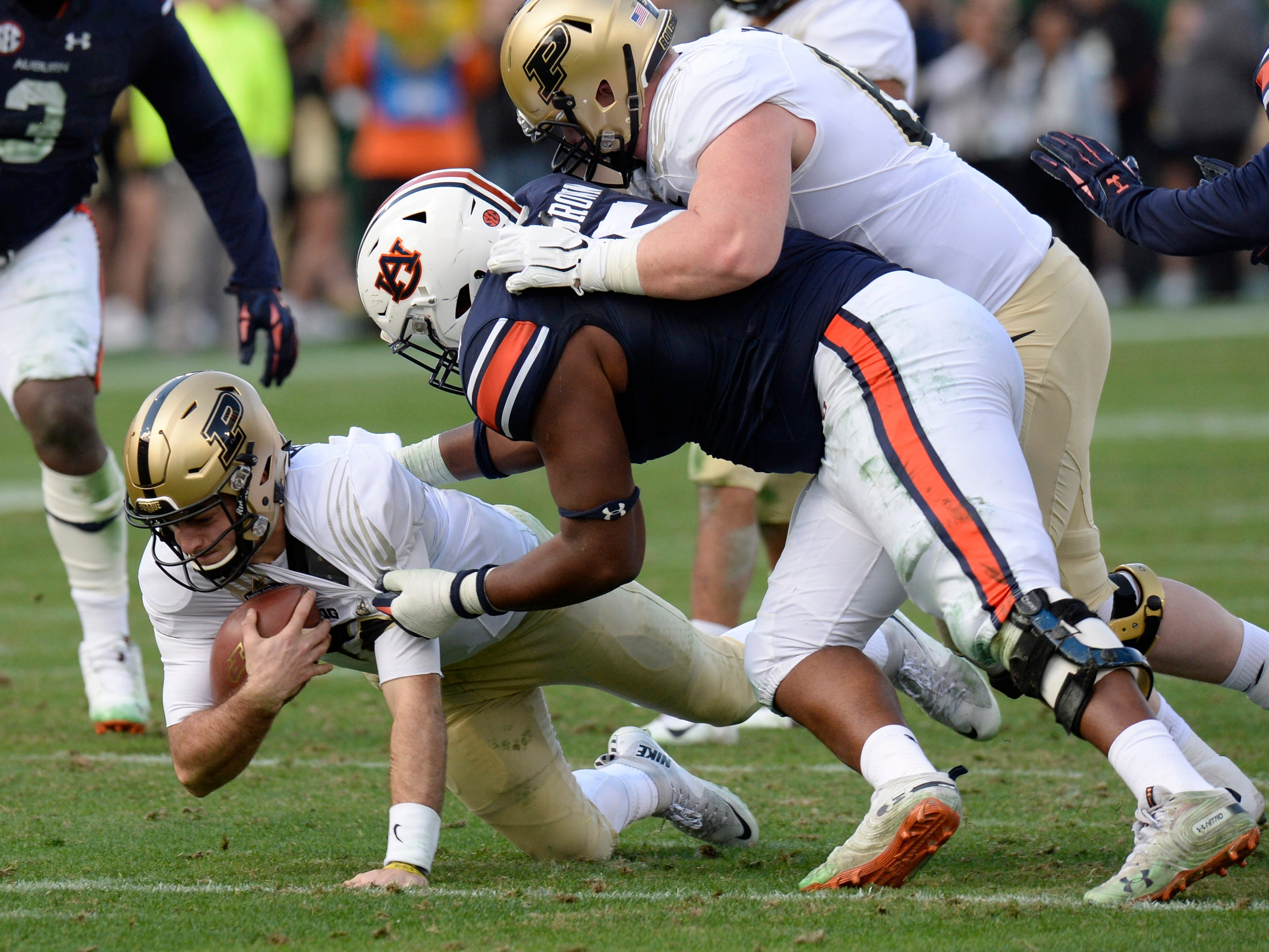 Auburn defensive lineman Derrick Brown (5) sacks Purdue quarterback David Blough (11) in the second quarter of the Music City Bowl NCAA college football game Friday, Dec. 28, 2018, at Nissan Stadium in Nashville, Tenn.