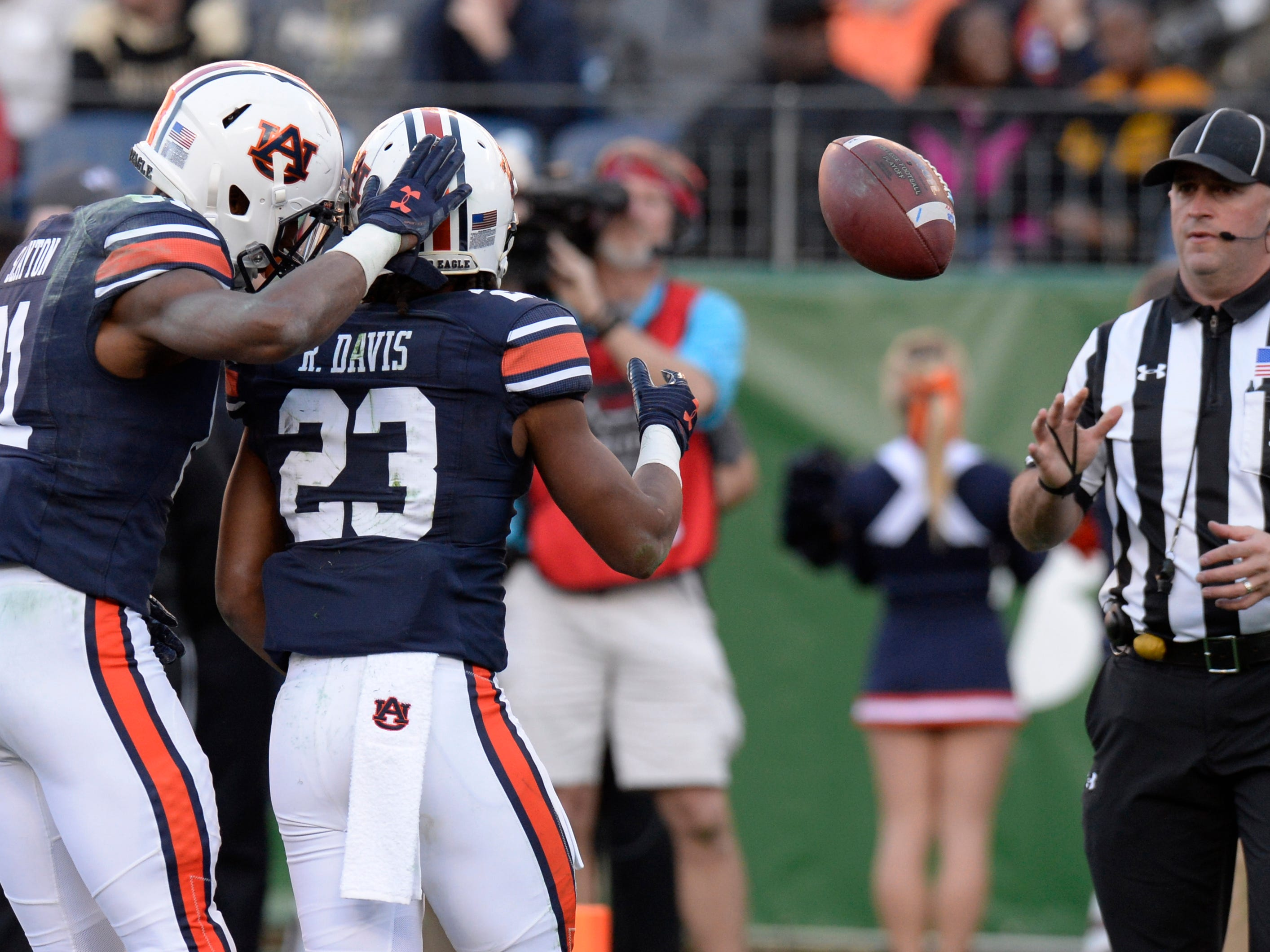 Auburn wide receiver Ryan Davis (23) celebrates his touchdown with wide receiver Darius Slayton (81) as tosses the ball to the referee in the third quarter of the Music City Bowl NCAA college football game Friday, Dec. 28, 2018, at Nissan Stadium in Nashville, Tenn.