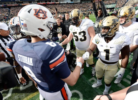 Auburn and Purdue players shake hands before the start of the Music City Bowl NCAA college football game Friday, Dec. 28, 2018, at Nissan Stadium in Nashville, Tenn.