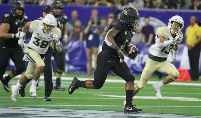 Vanderbilt running back Ke'Shawn Vaughn (5) goes in for his second touchdown of the game in the Texas Bowl on Thursday. Vaughn finished with 243 yards and two scores on just 13 carries.