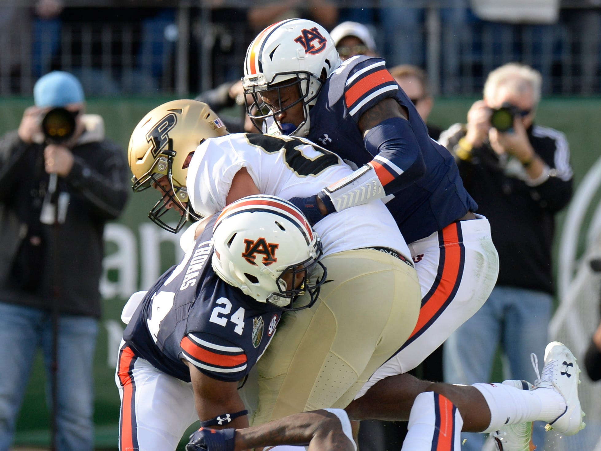 Auburn defenders bring down Purdue running back Markell Jones (8) in the first half of the Music City Bowl NCAA college football game Friday, Dec. 28, 2018, at Nissan Stadium in Nashville, Tenn.